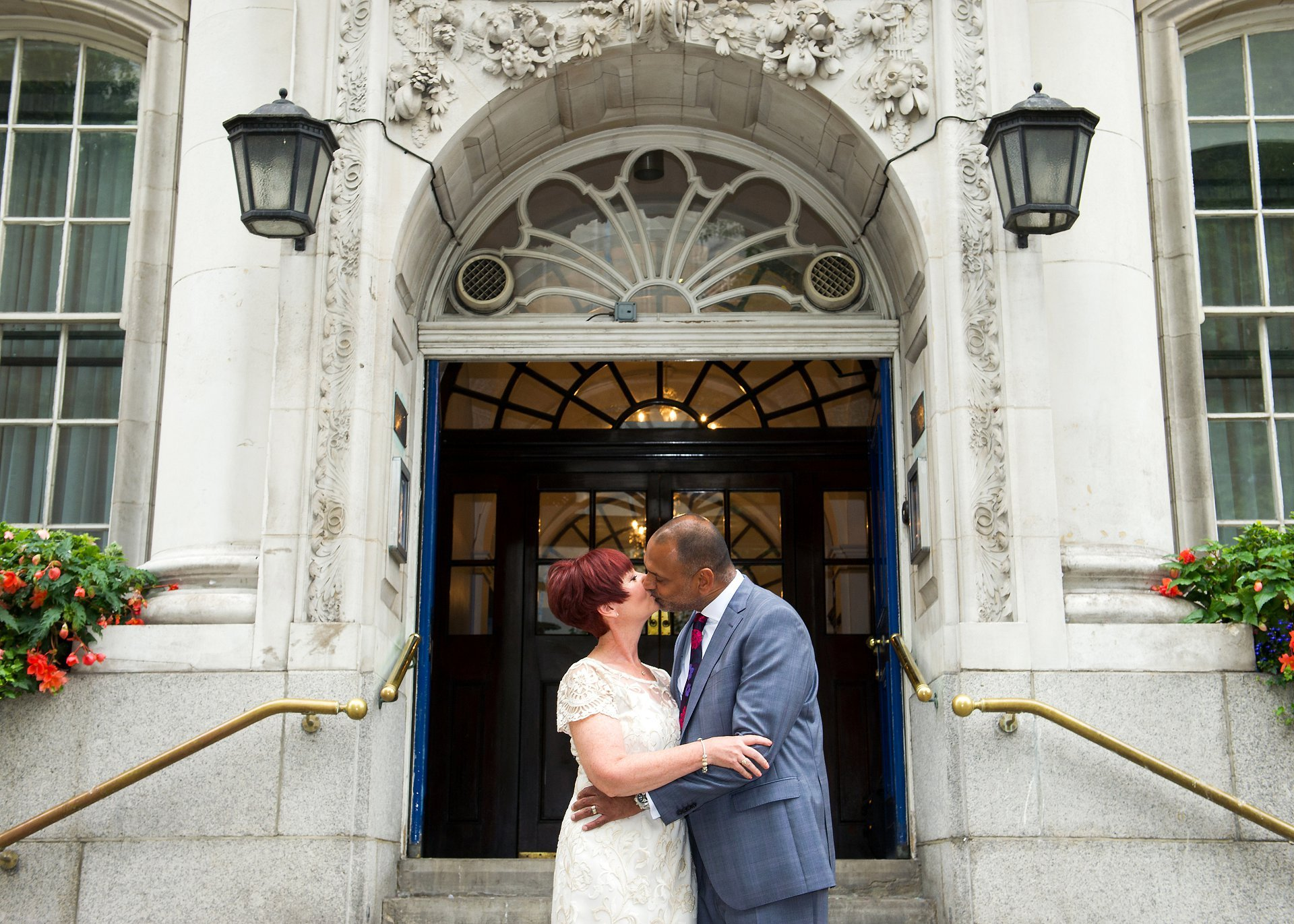 Bride & groom kissing on the famous Chelsea steps