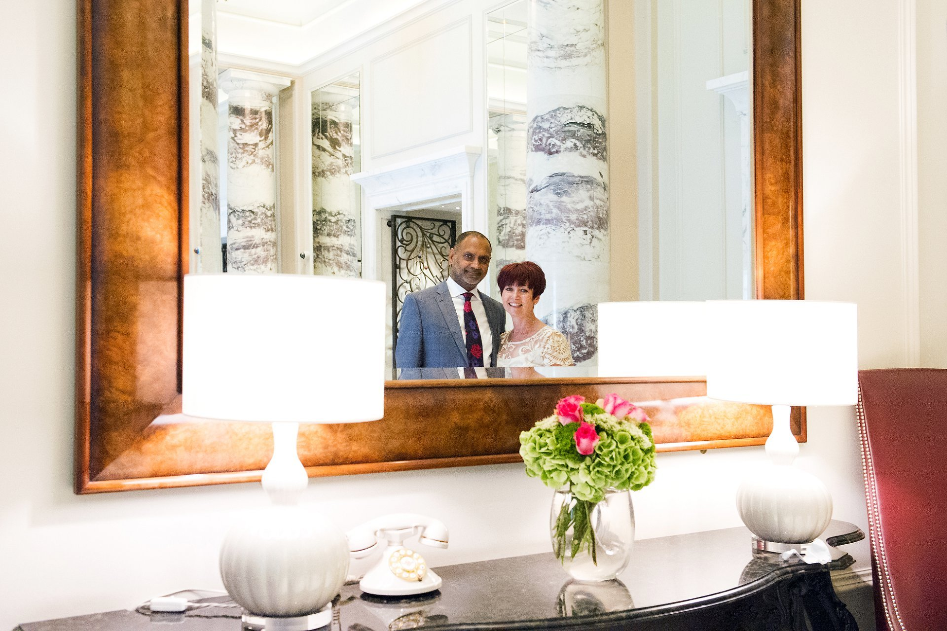 Langham wedding reception for this happy couple shown here after their civil wedding ceremony in the lobby of this famous 5 star London hotel, ideal for wedding celebrations large and small