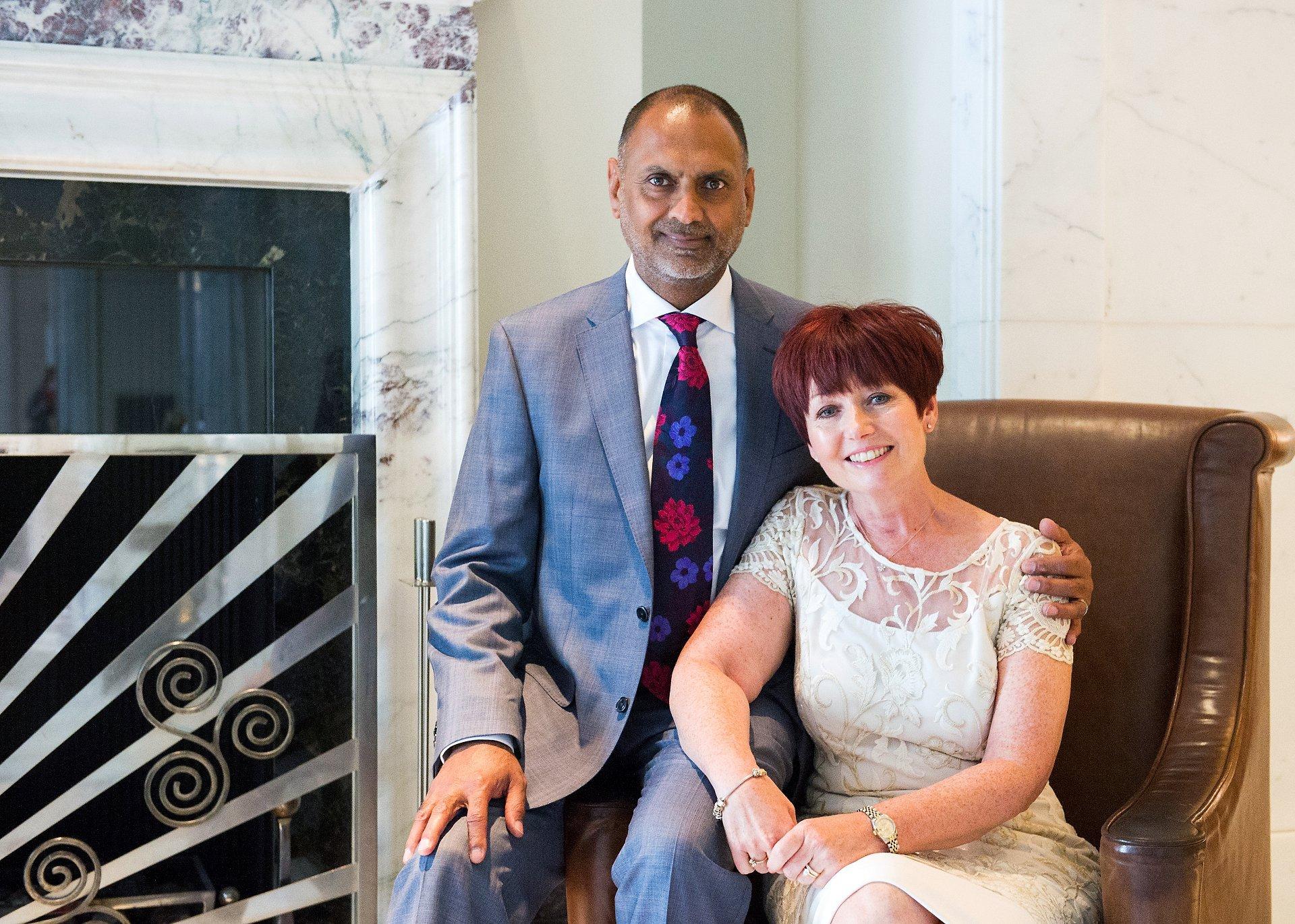 Bride & groom in the lobby of the Langham Hotel London