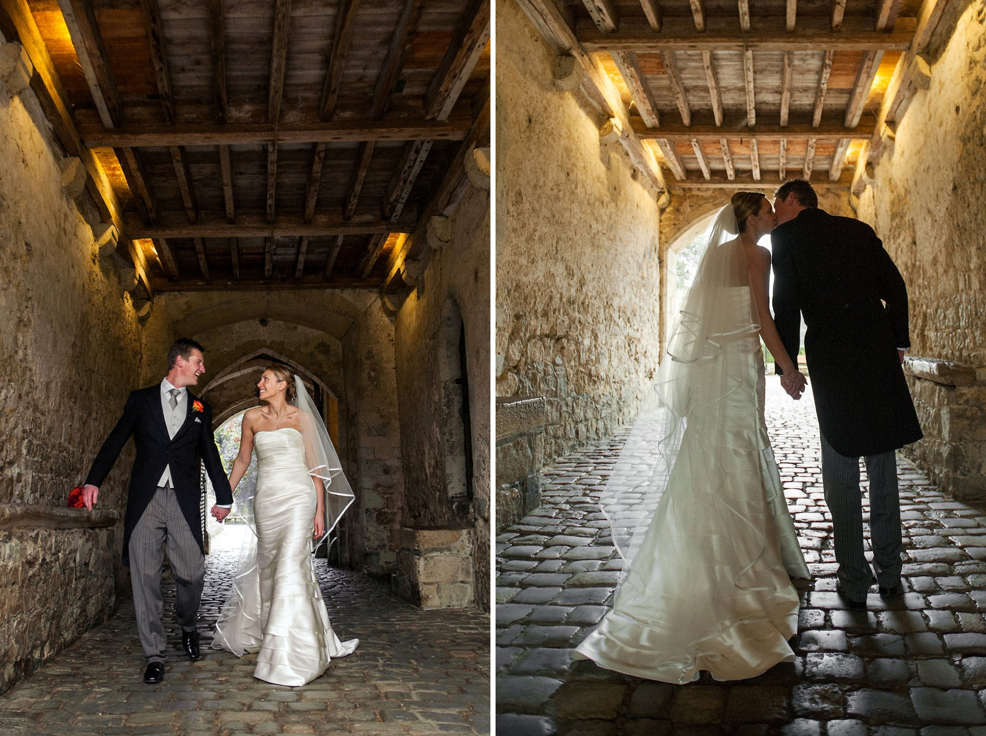 The Leeds Castle Gatehouse makes for dramatic wedding photographs including a silhouette here of Amy and Andrew as they walk towards the ruin and portcullis