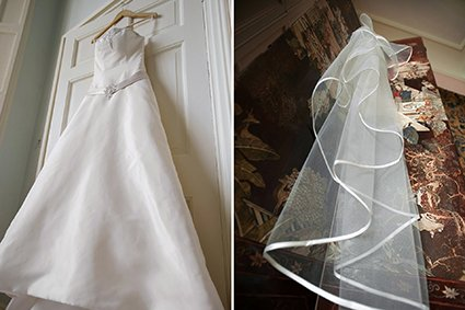 A wedding dress and veil hanging in the Turret bedroom on the first floor of historic Leeds Castle