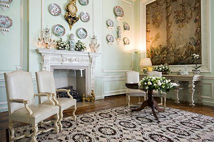 The elegant Fench Caen stone fireplace with wall plates and tapestries act as a wonderful backdrop to civil ceremonies at Leeds Castle and are done by Registrars from Kent County Council