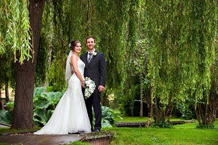 Leeds Castle wedding photographer Emma Duggan specialises in photography at this idyllic kent wedding venue - here the couple pose under the romantic weeping willow