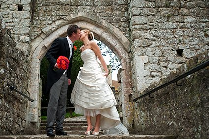 The portcullis and ancient ruin just outside teh Gatehouse at Leeds Castle makes a wonderful backdrop to wedding photos
