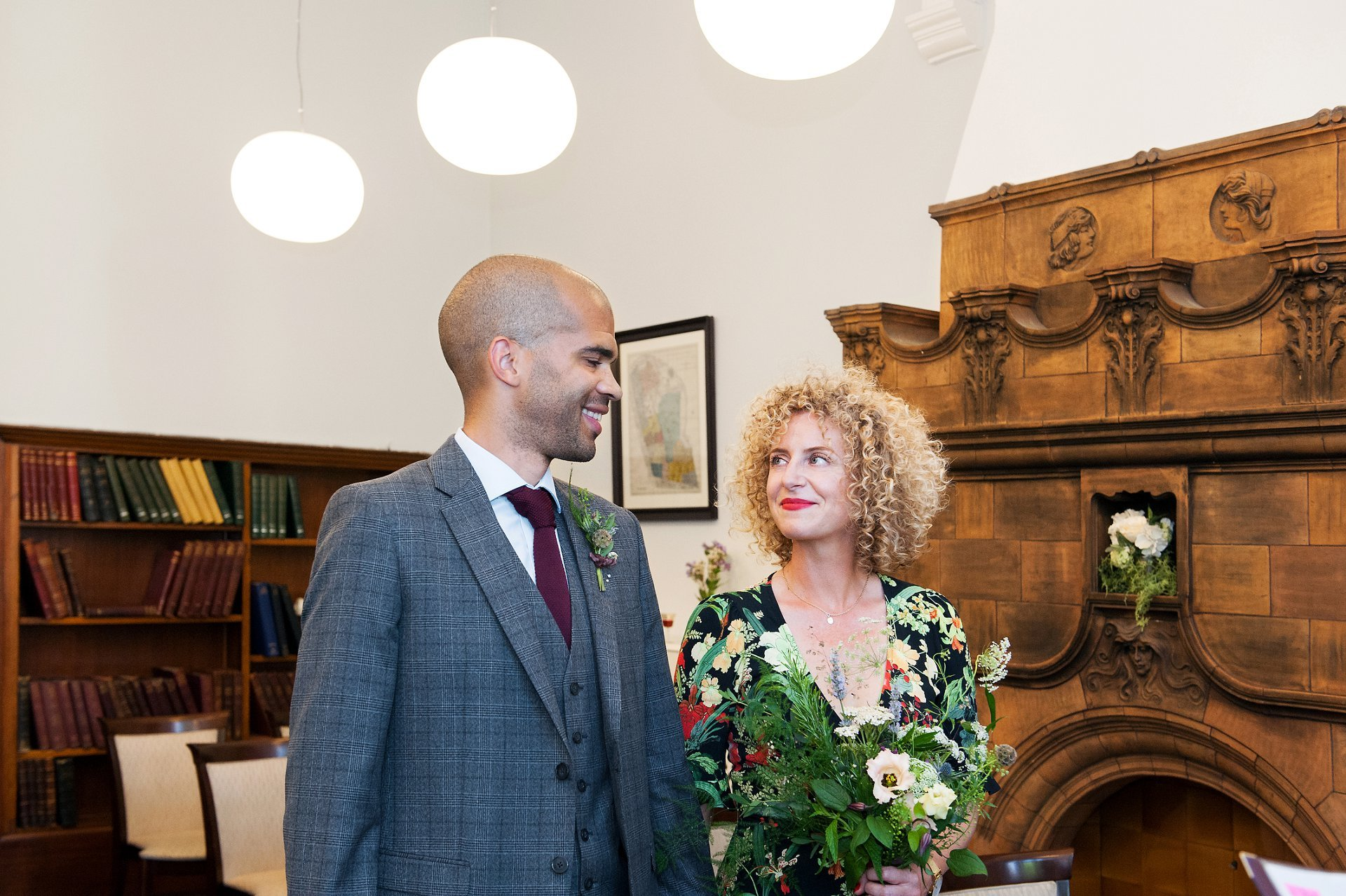 Mayfair Library wedding photographer Emma Duggan at the start of the civil ceremony of Jodie and Adrian, with the couple smiling at each other