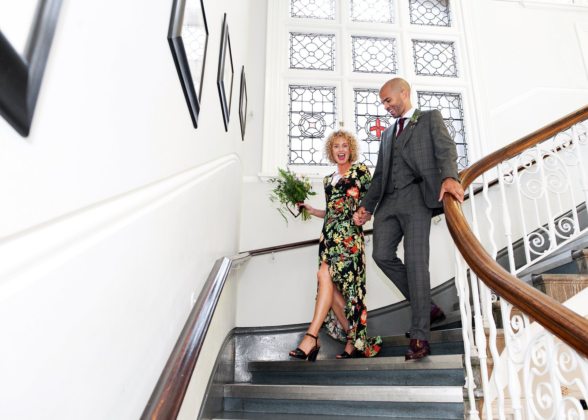 Bride & groom walking down the stairs at Mayfair Library on South Audley Street