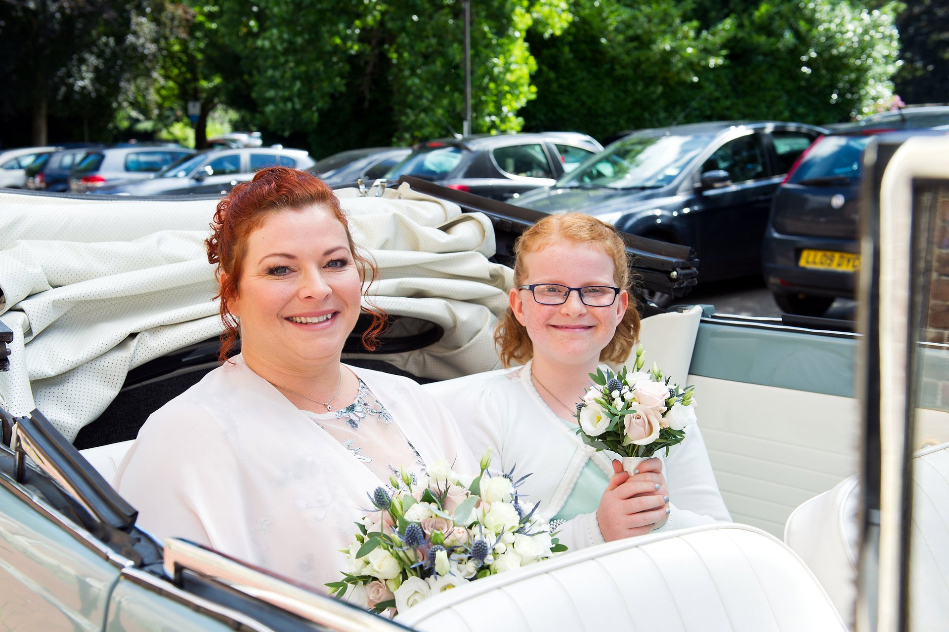 The bride and her daughter arrive in VW Beetle Marsha from Bowfield Hire at Park House in Horsham