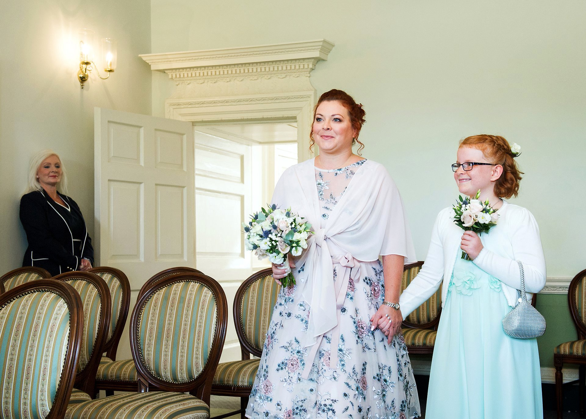 Horsham Register Office with the bride and her daughter walking up the aisle of the Drawing Room at Park House smiling at the groom
