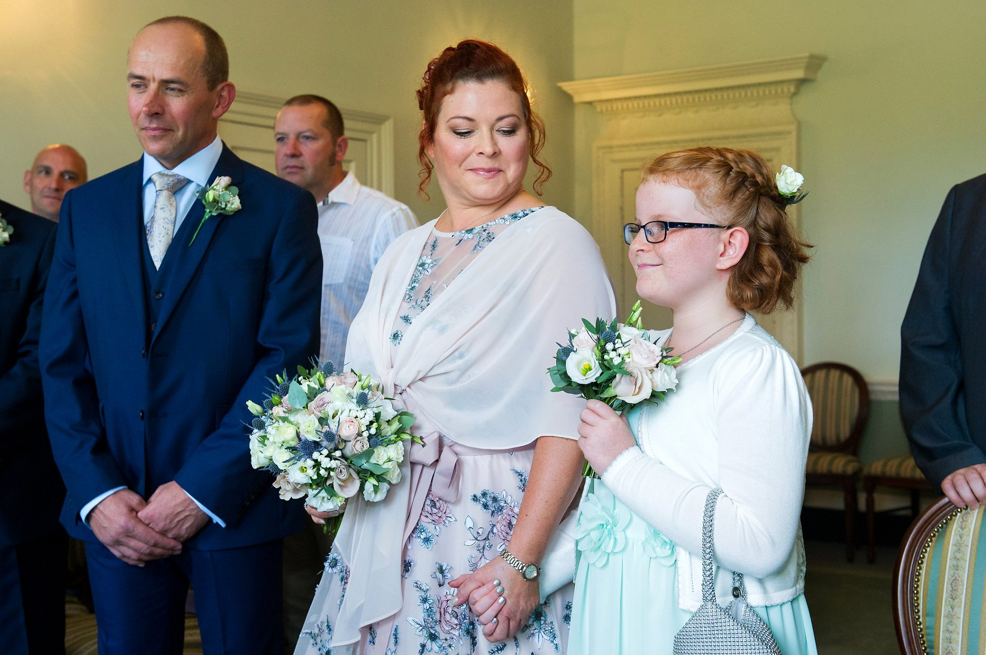 Horsham Registry Office is on North Street and is adjacent to Horsham Park adn the Conservatory Cafe. It is a wonderful West Sussex wedding venue. The bride in the Drawing Room looks at her daughter at the start of this civil marriage ceremony