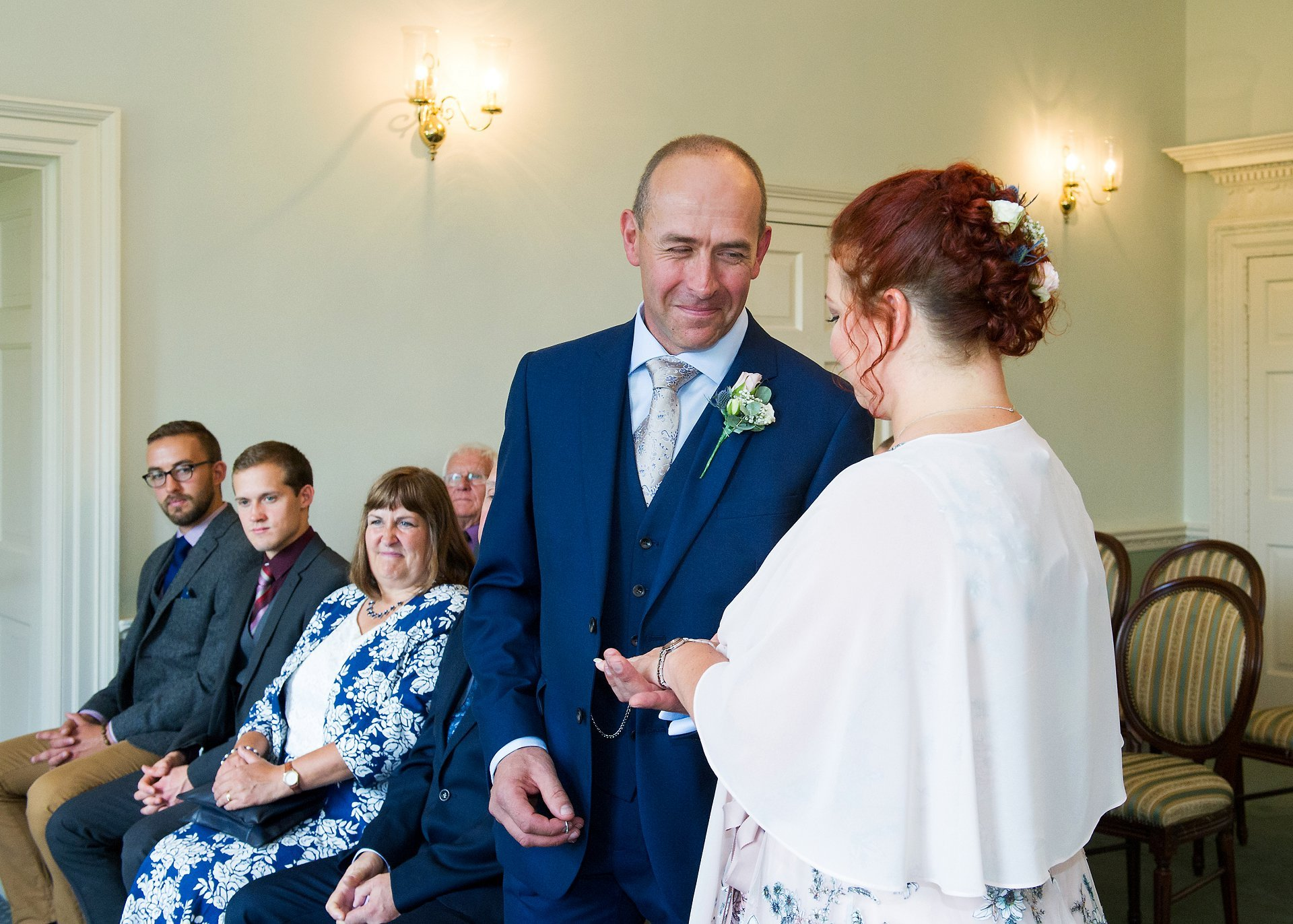 Horsham Registration Office is a charming West Sussex wedding venue with a garden and nearby cafe and plenty of parking - the bride and groom shown here during their Drawing Room civil ceremony