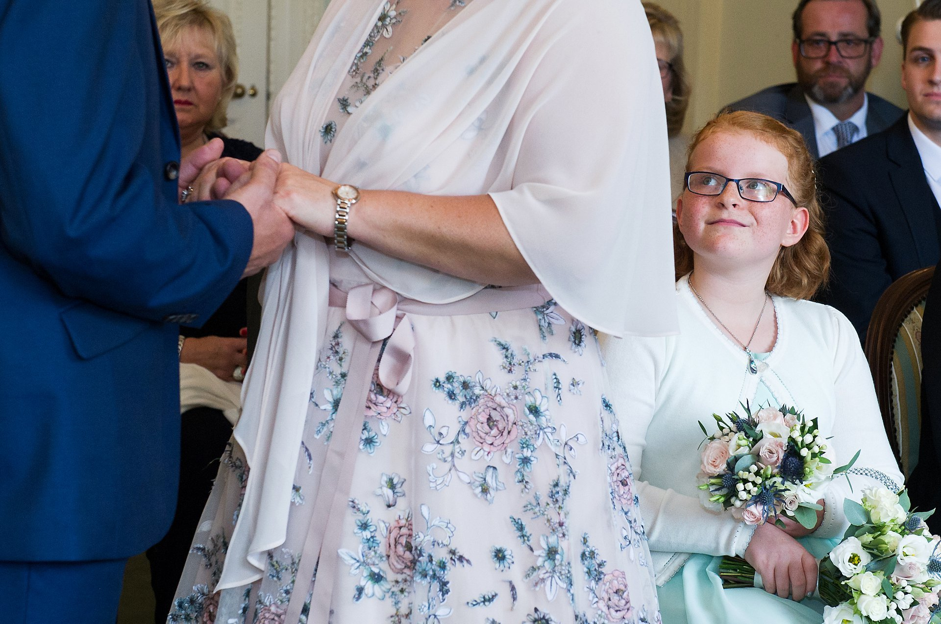 The bride's daughter watches as her mother excahnges vows during this West Sussex civil ceremony