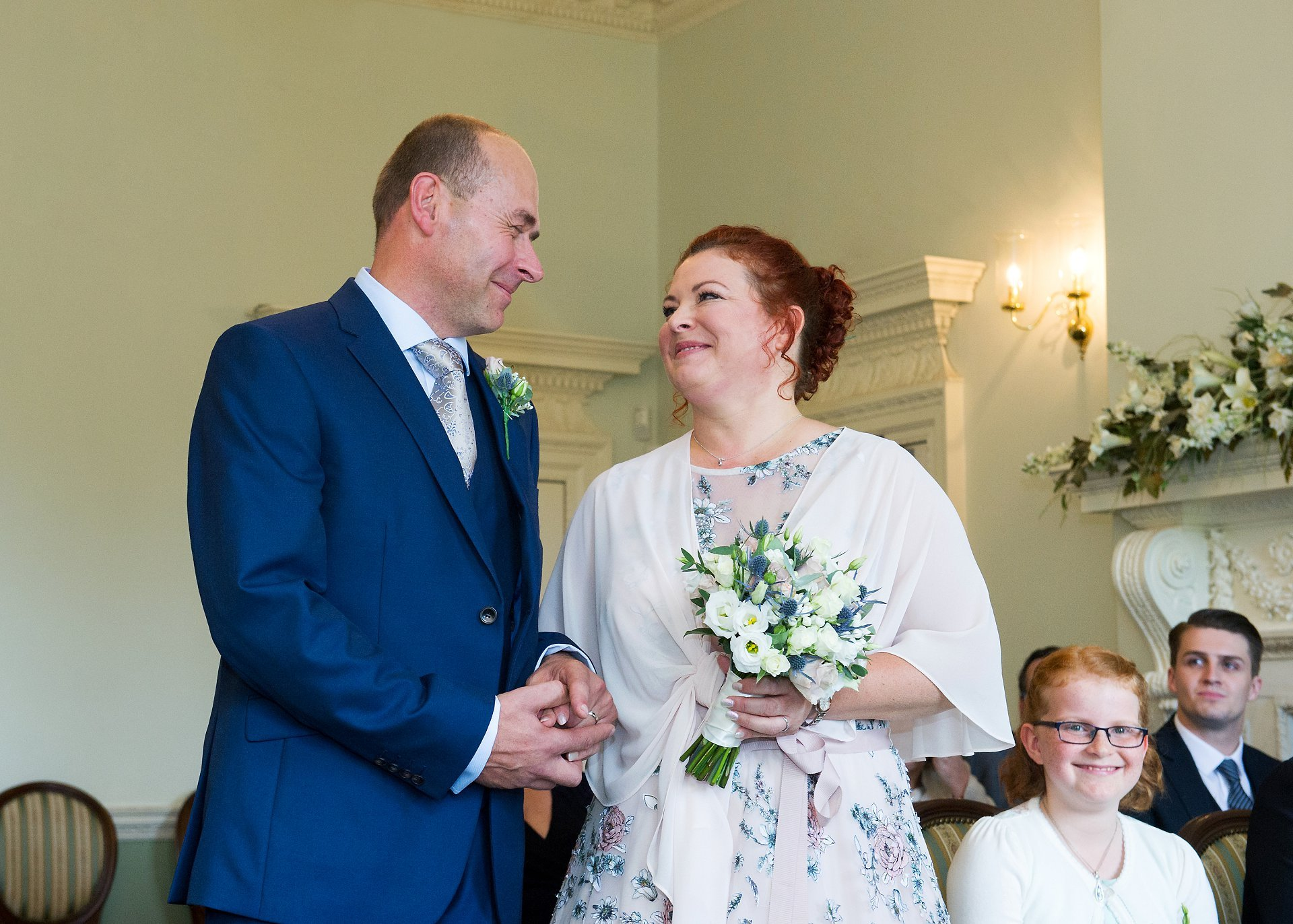 Park House Horsham wedding photographer Emma Duggan photographs couples at their civil ceremonies throughout West Sussex, here a bride and groom are announced as man and wife in the Horsham Register Office