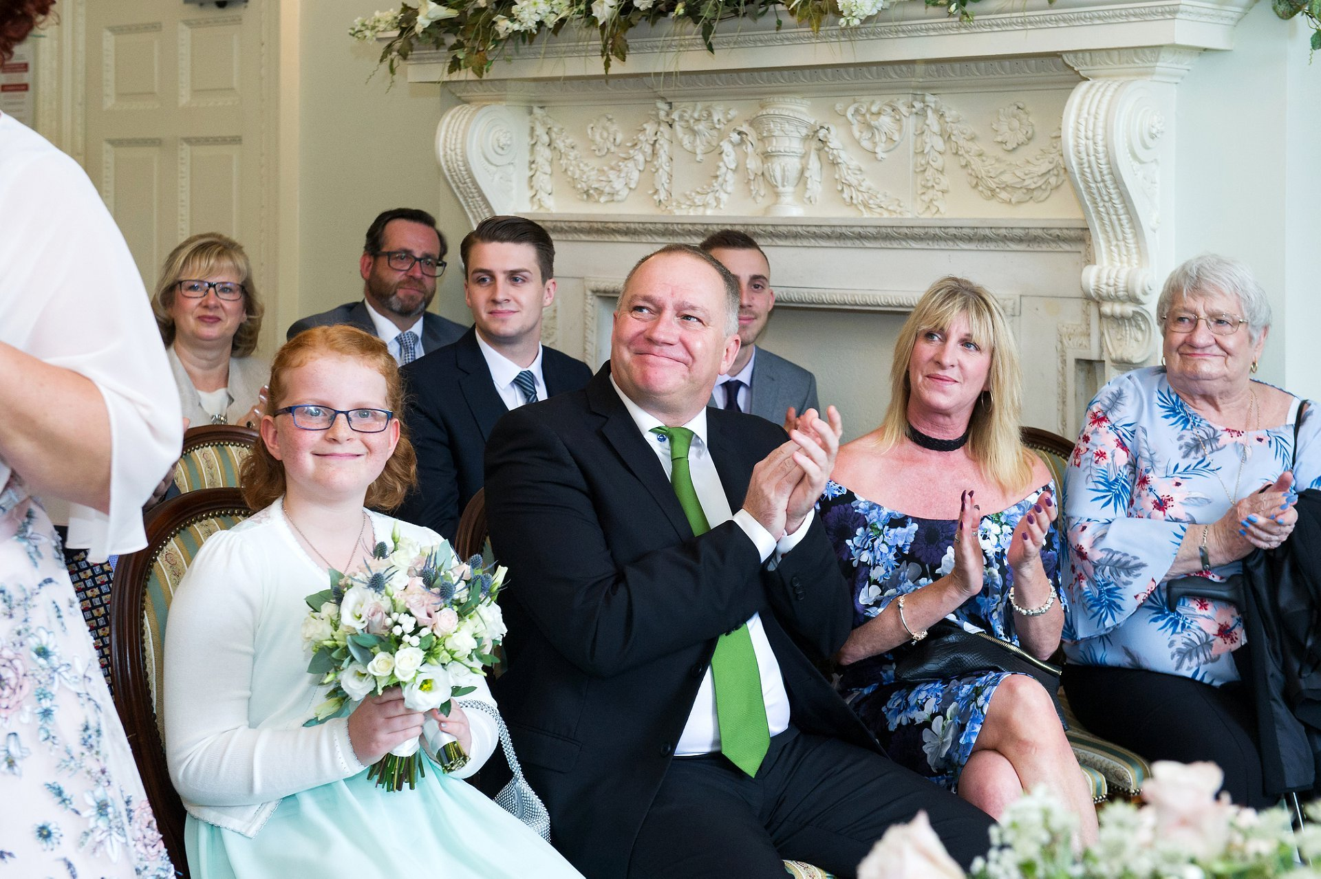 Guests clap their congratulations to the bride and groom in the Drawing Room at Park House in North Street, Horsham