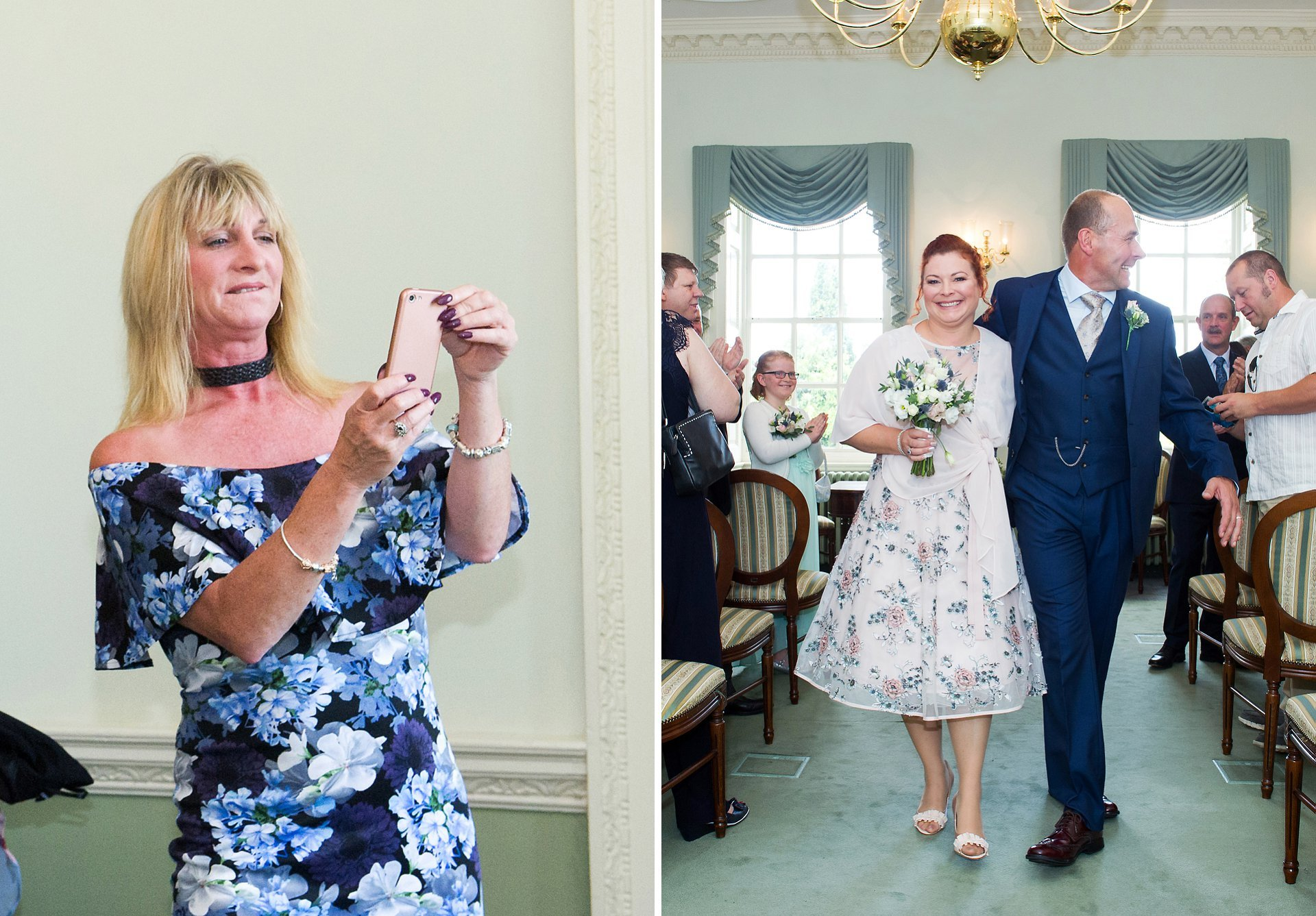 A guest photographs the bride and groom leaving the Drawing Room ceremony room at Park House in Horsham, aka Horsham registration office