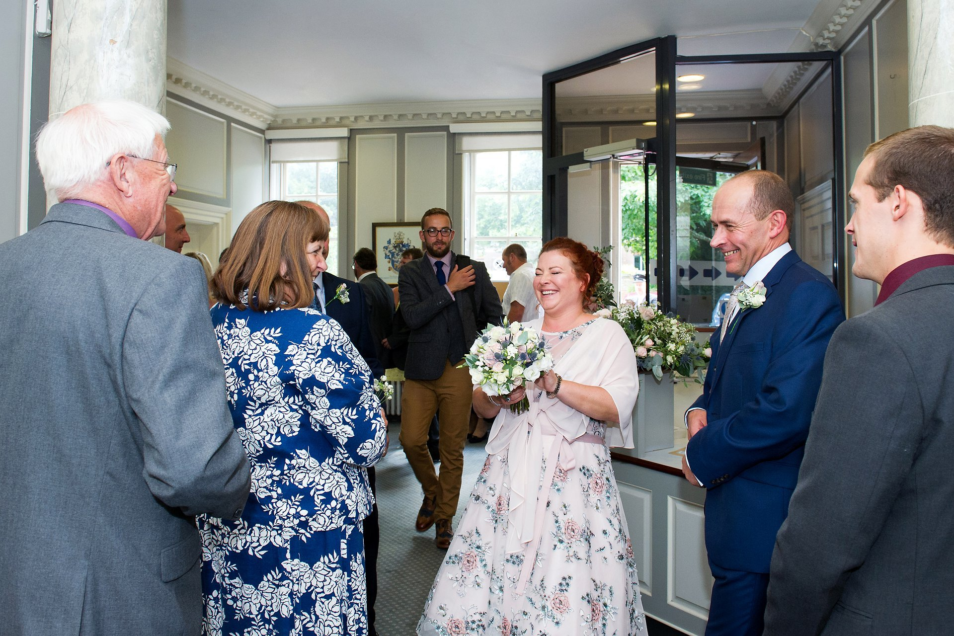 Bride laughing after her Horsham Register Office marriage ceremony