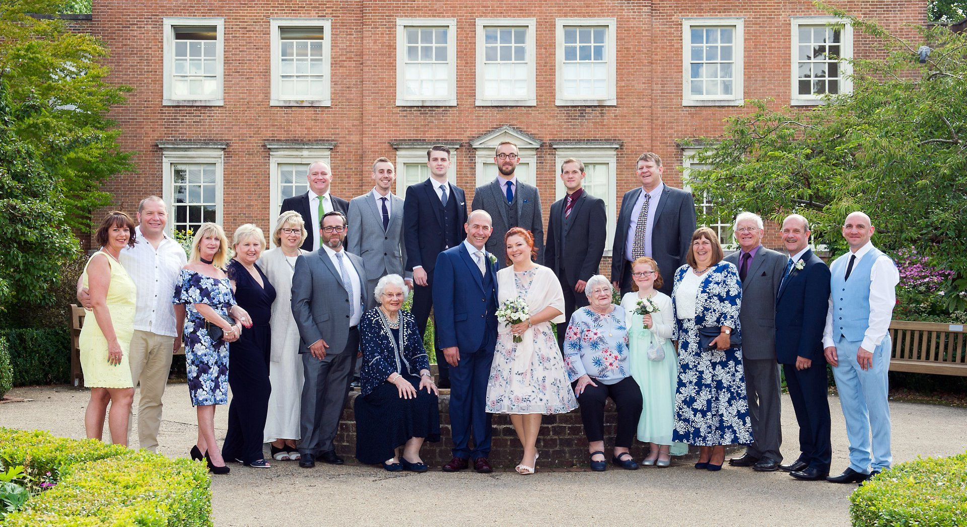 Park House Horsham wedding photography is perfect for group photographs in the enclosed garden behind the 17th century Georgian house which is Grade II listed - this group photograph works really well and shows all the bride and groom's wedding guests
