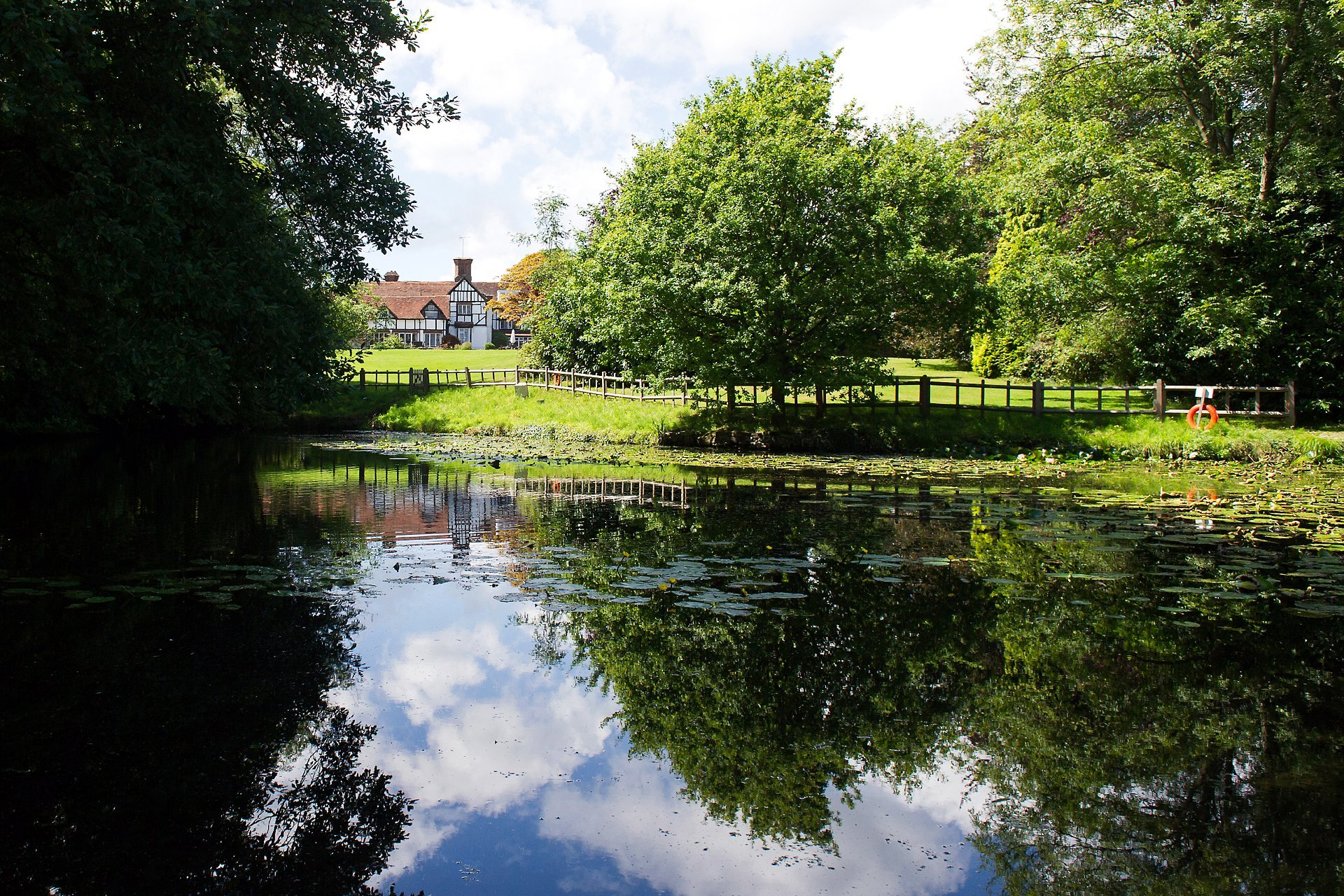 Ghyll Manor Horsham is a country house wedding venue will a large lawn, gardens and pretty pond