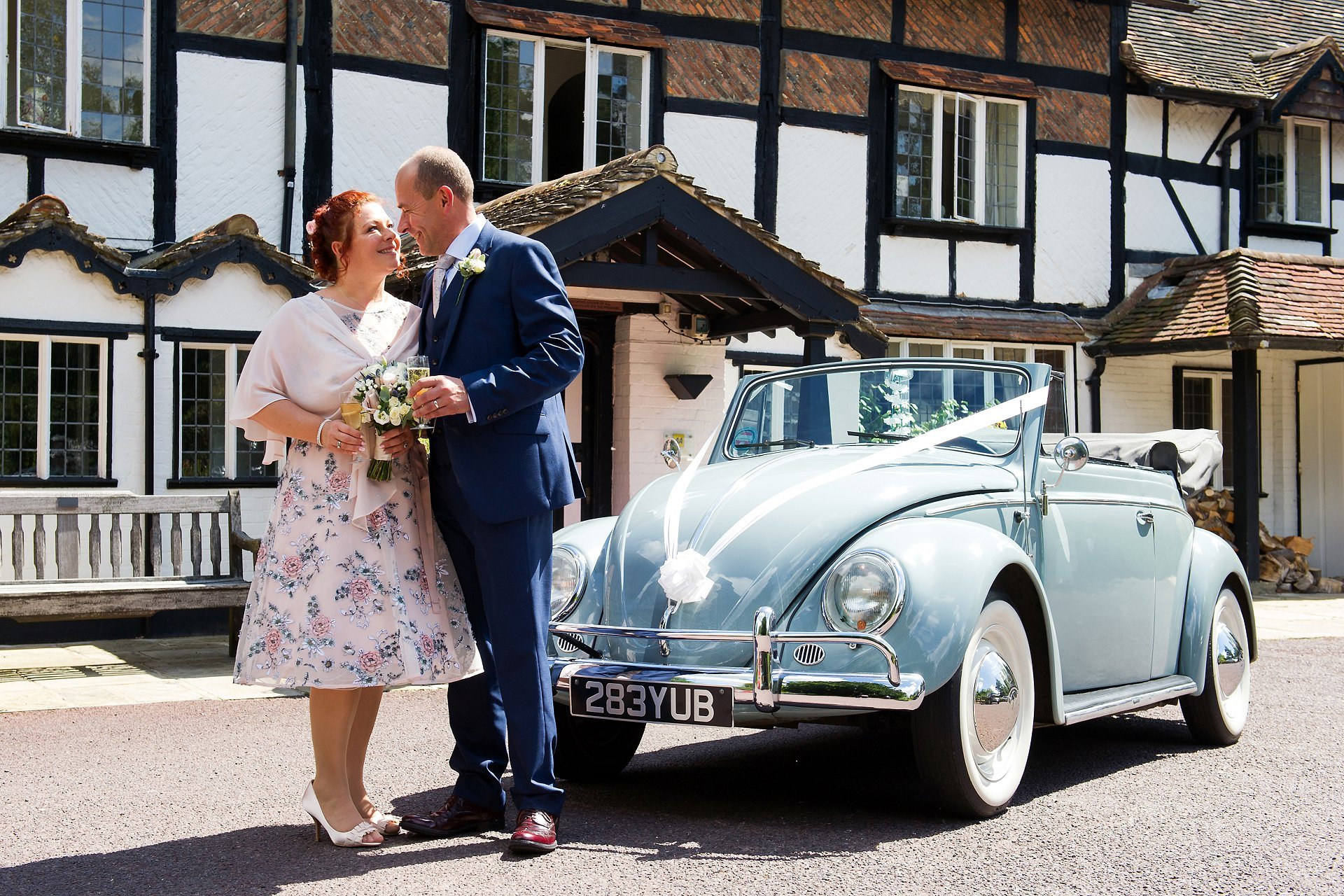 Bride and groom in front of the entrance to Ghyll Manor