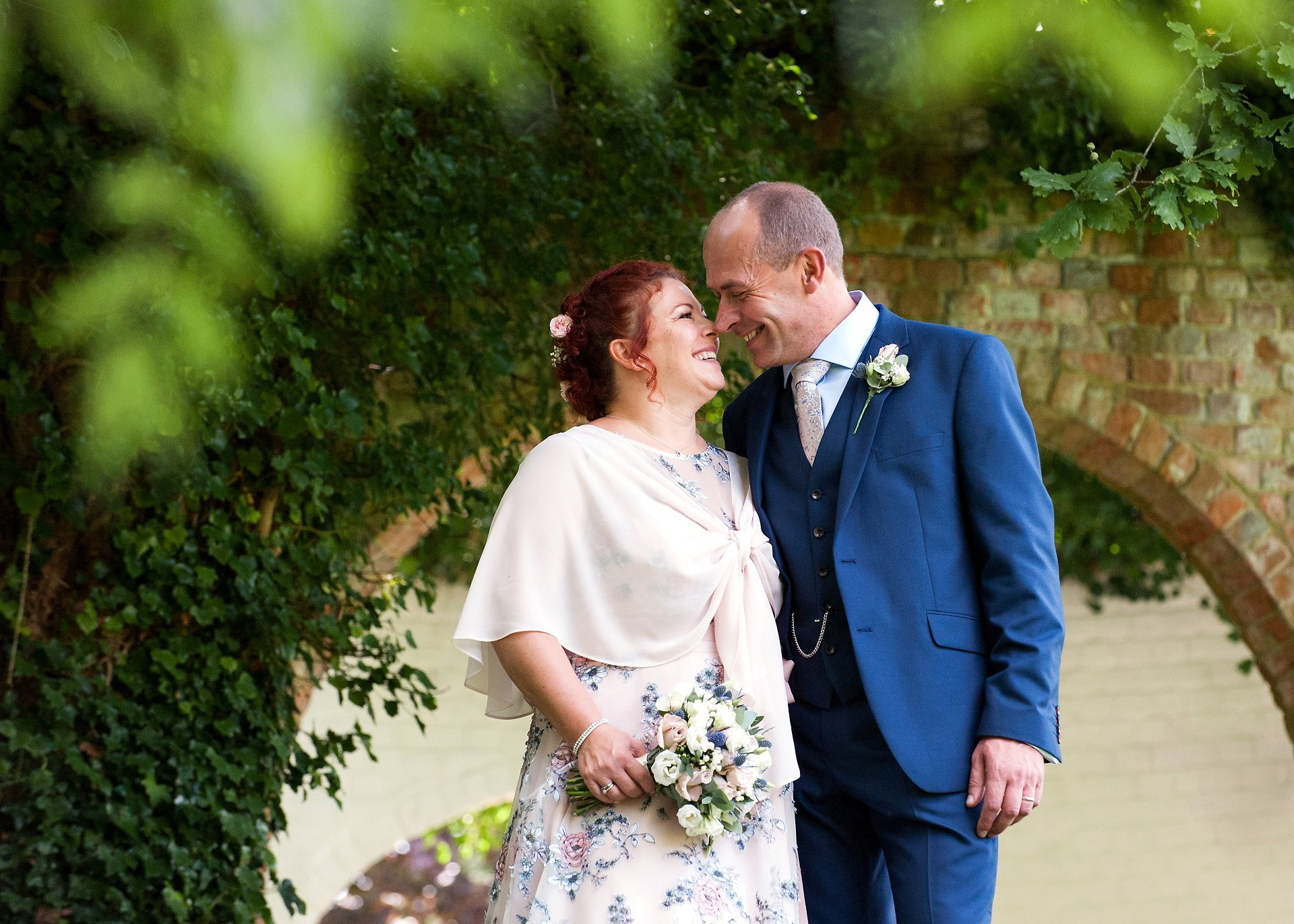 A bride and groom celebrate their wedding day at Ghyll Manor near Horsham in West Sussex