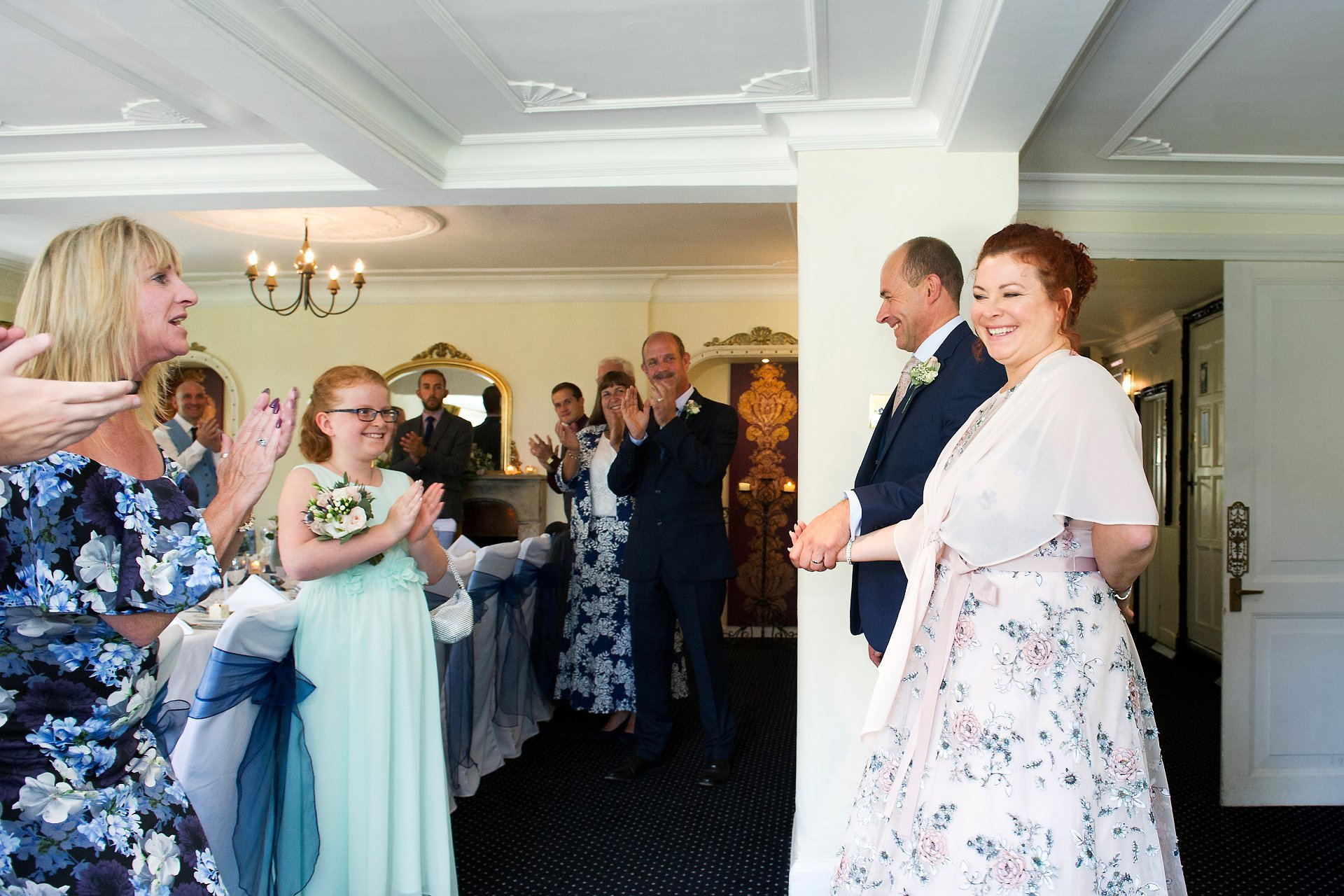 Bride and groom entering the Terrace Room at Ghyll Manor near Horsham for their wedding brekfast for a small, intimate group of wedding guests