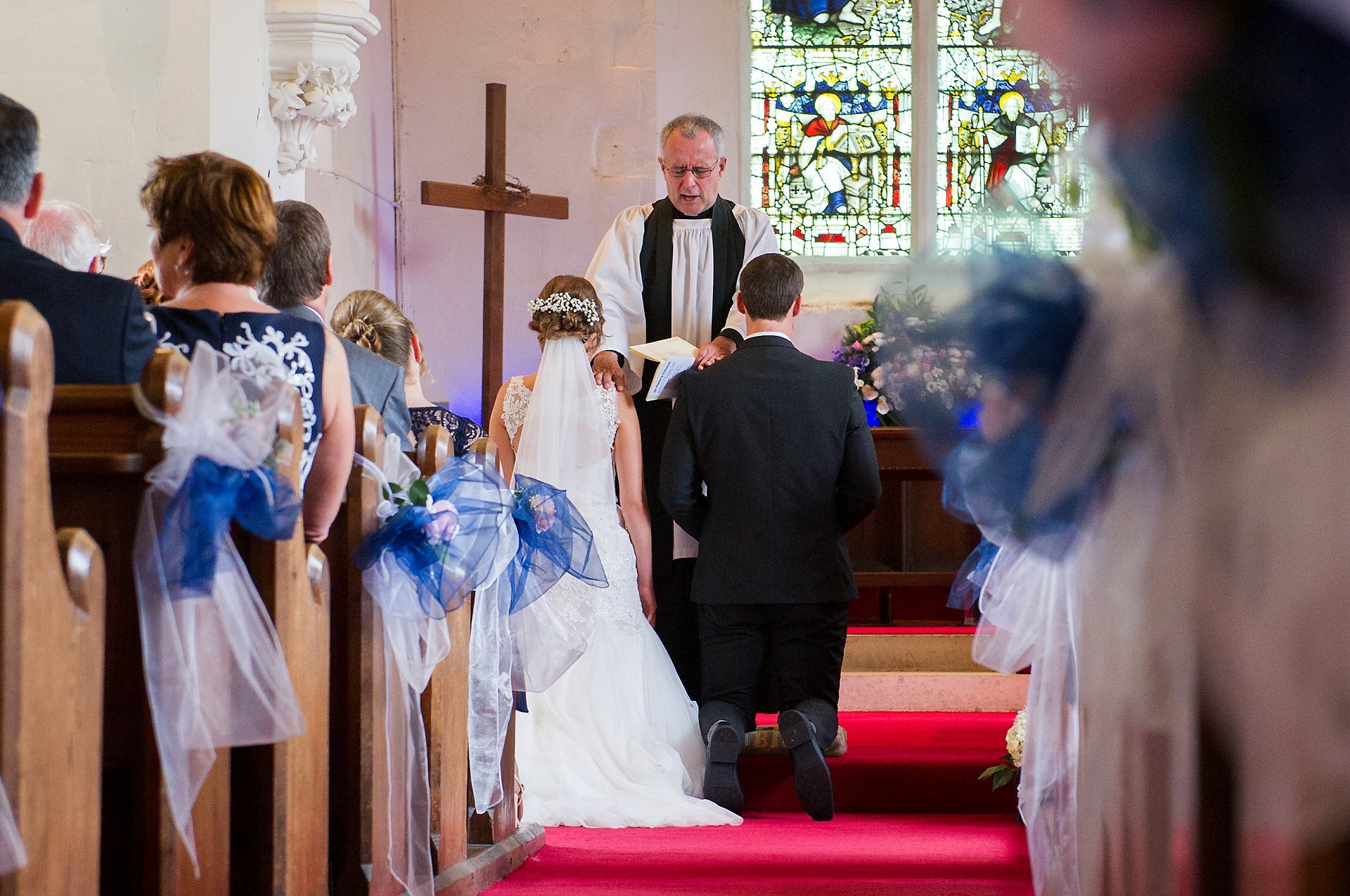The blessing of the couple's marriage takes place inside St Peter's Ditton
