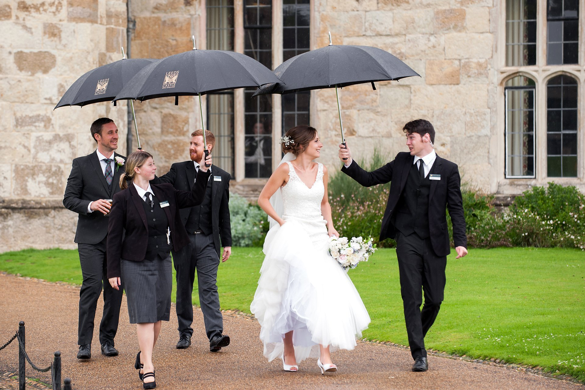 Leeds Castle staff joking with the bride on her wedding day