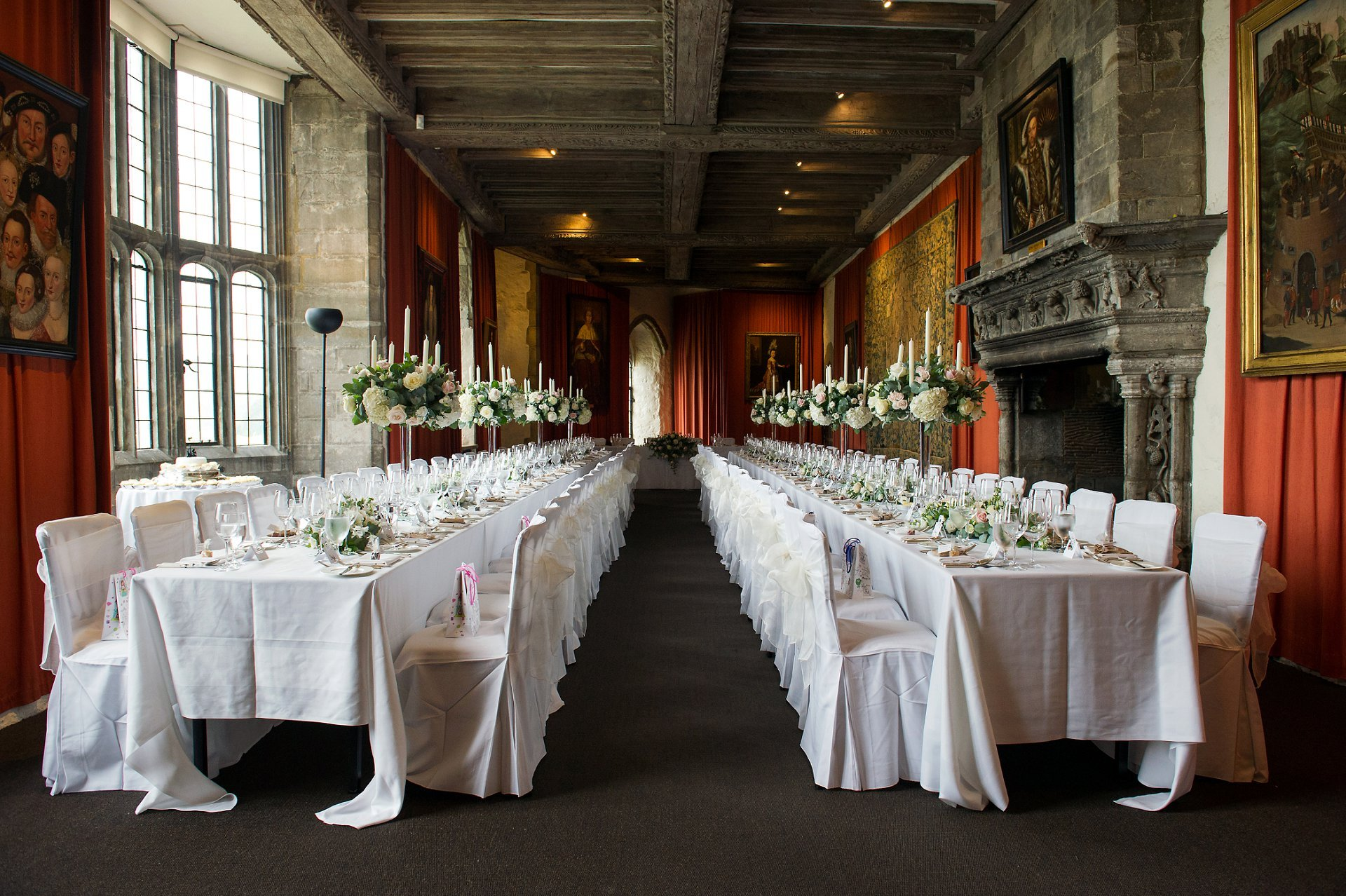 Henry VIII Banqueting Hall dining room at Leeds Castle laid for a wedding breakfast photographed by Leeds Castle wedding photogrpaher Emma Duggan