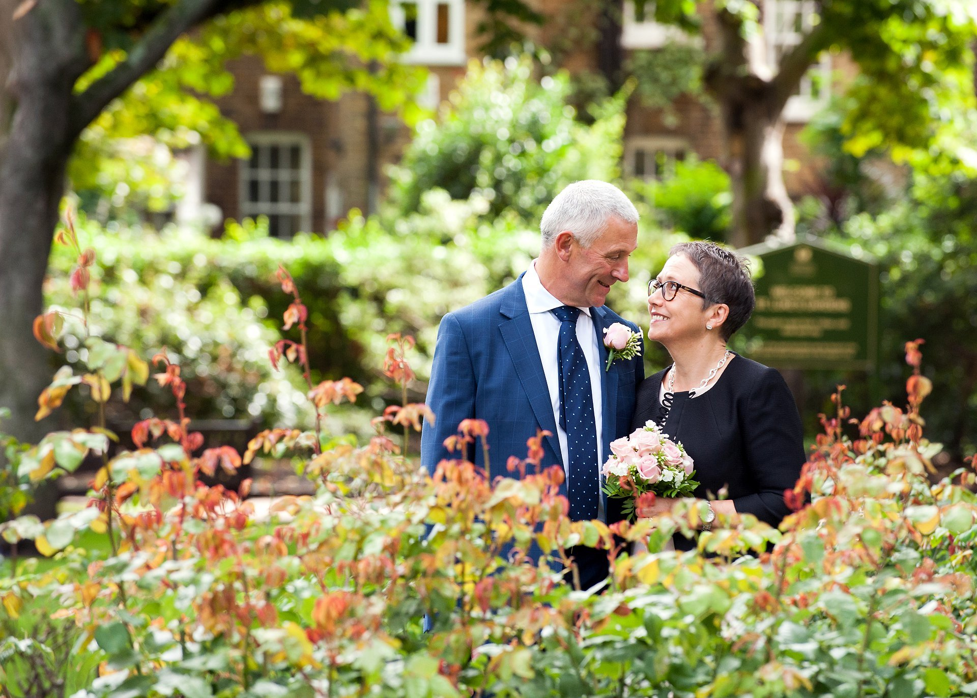 a bride and groom portrait in st luke's gardens near chelsea old town hall