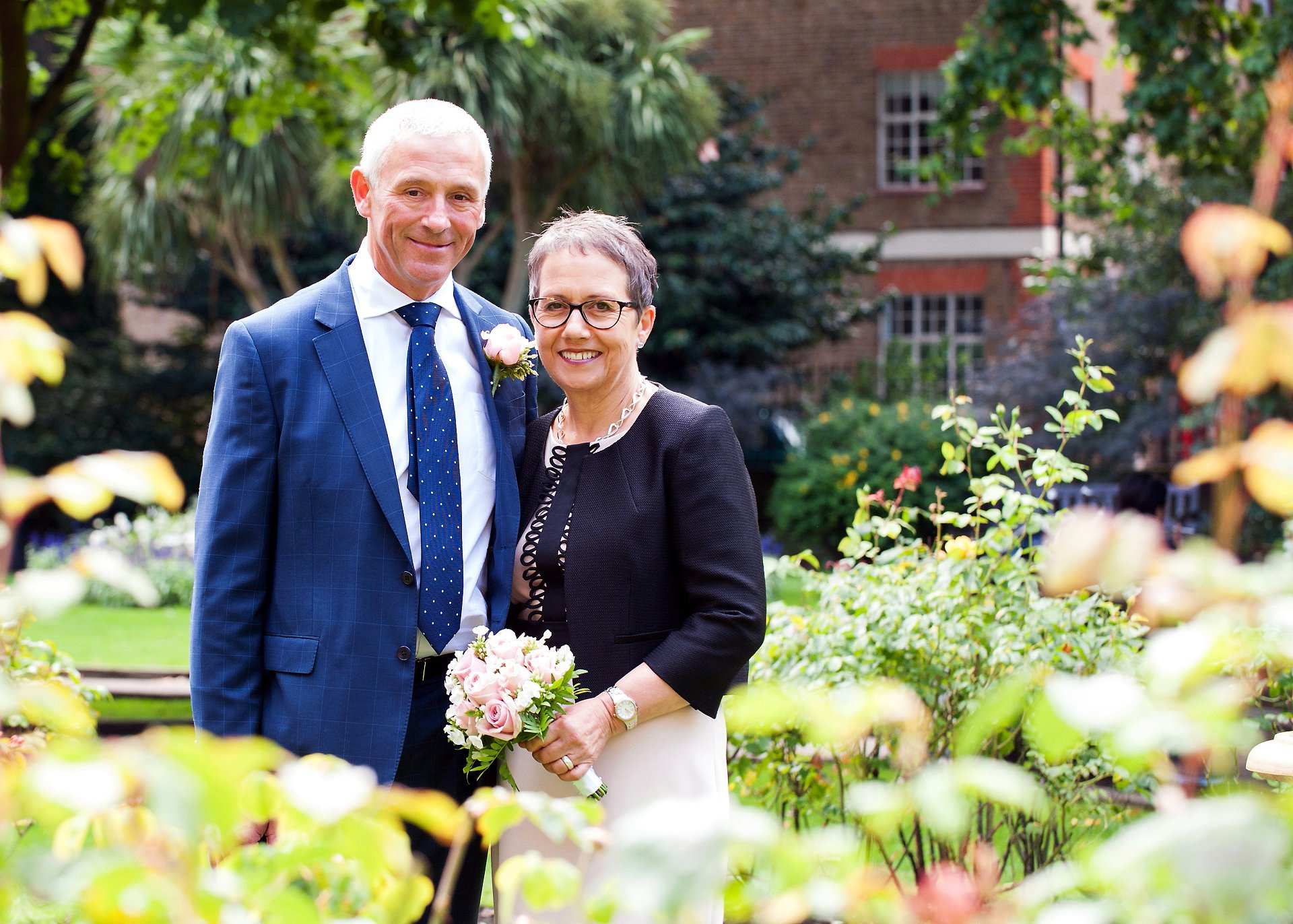 a bride and groom in gardens near chelsea register office