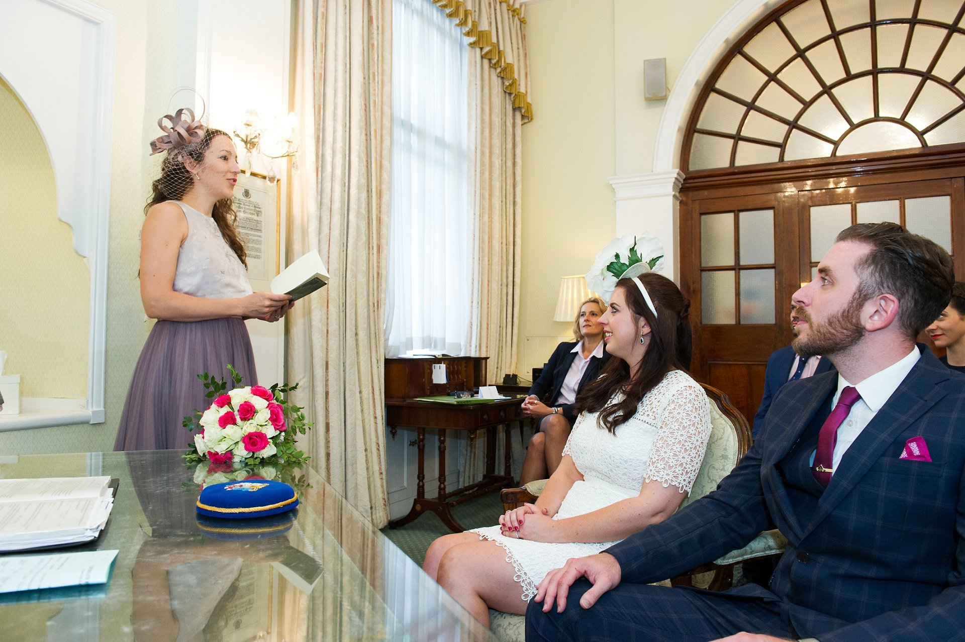 A wedding guest delivers a reading in the Rossetti Room - Chelsea Registry Office wedding photography by specilist Emma Duggan