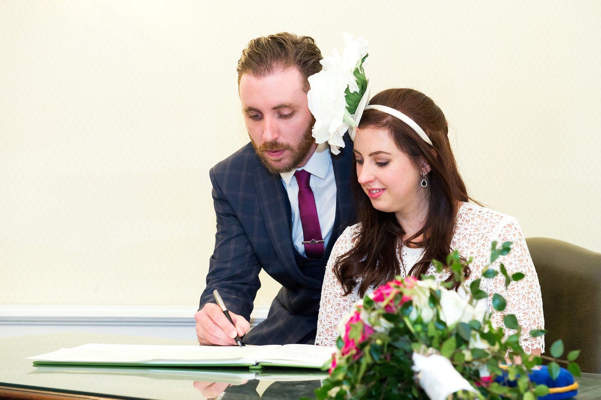A bride and groom register their civil ceremony in Chelsea Old Town Hall's Rossetti Room