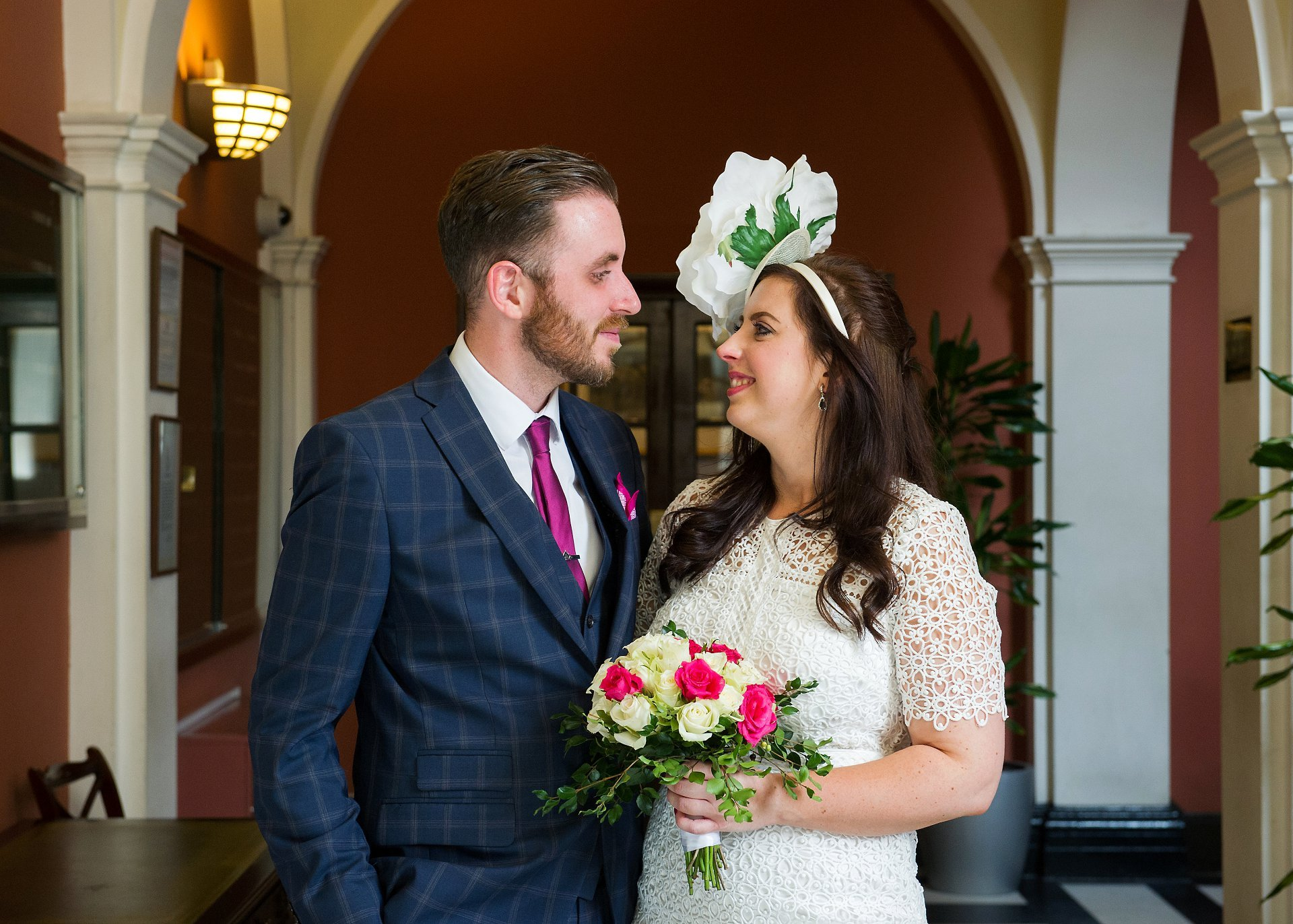 A bride and groom in the waiting room at Chelsea Registry Office by Chelsea Old Town Hall wedding photographer Emma Duggan