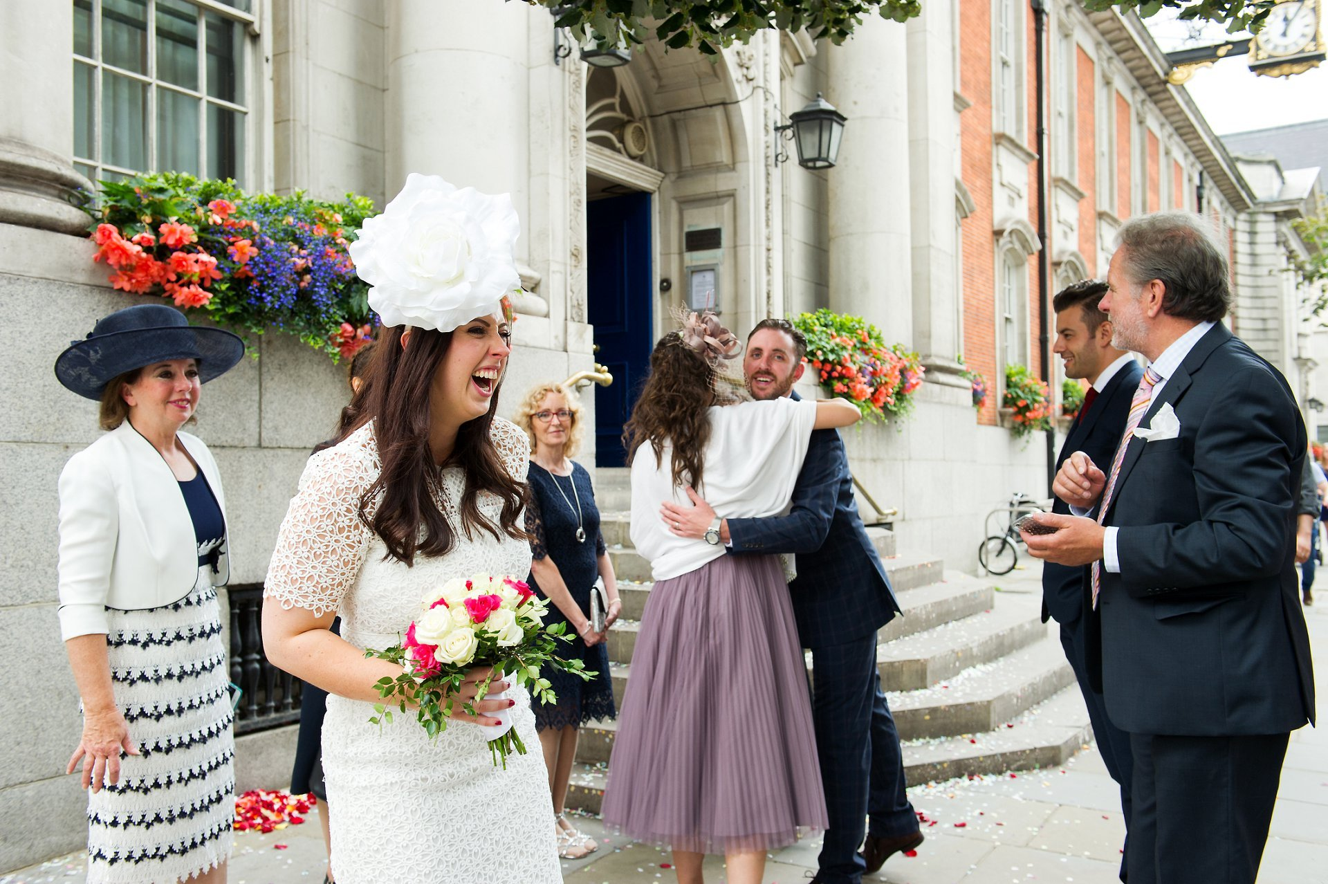 London wedding photography capturing the joy of a recently married bride outside Chelsea Register Office