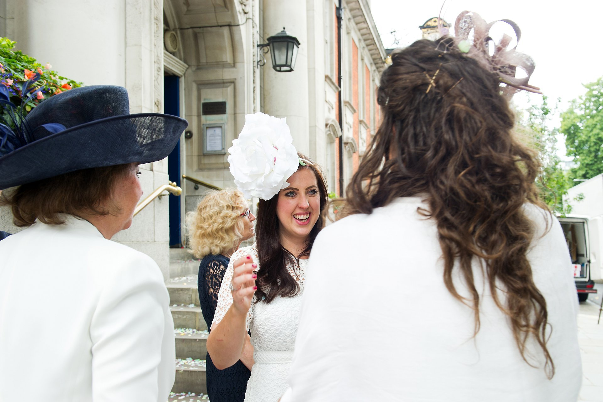 Bride smiling outside Chelsea Old Town Hall