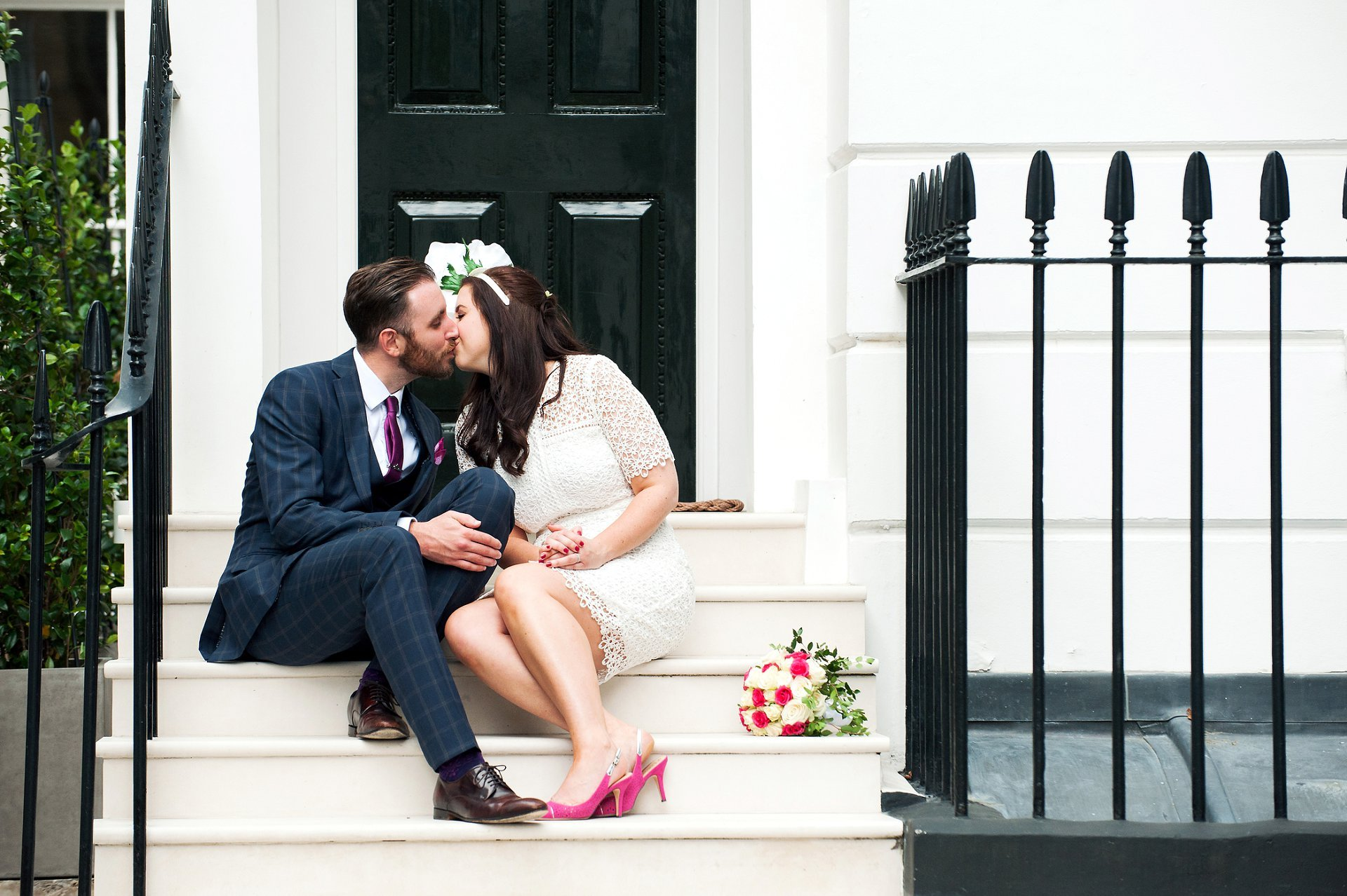 Chelsea wedding photographer, Emma Duggan, photographs this bride and groom on a Chelsea step as they kiss