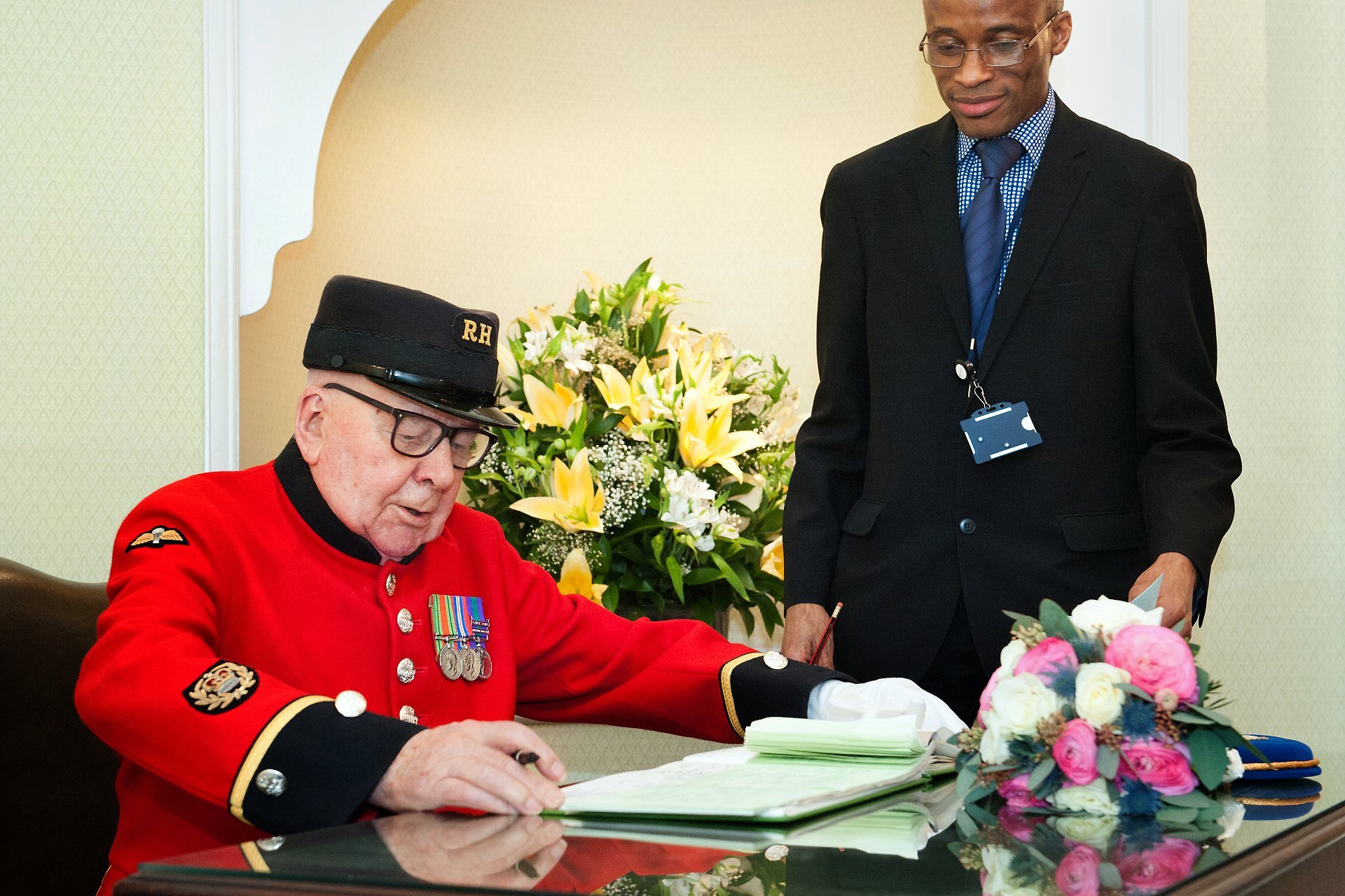 A Chelsea Pensioner acting as a witness to a couple's civil marriage ceremony in the Rossetti Room at Chelsea Old Town Hall