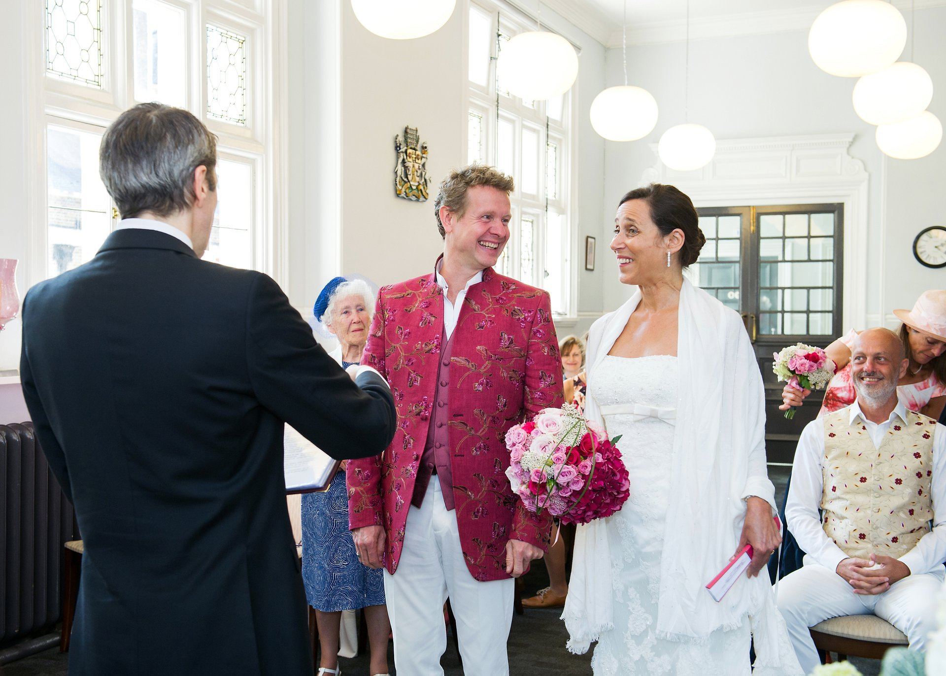 The Registrar greets the bride and groom at the start of their mayfair library wedding