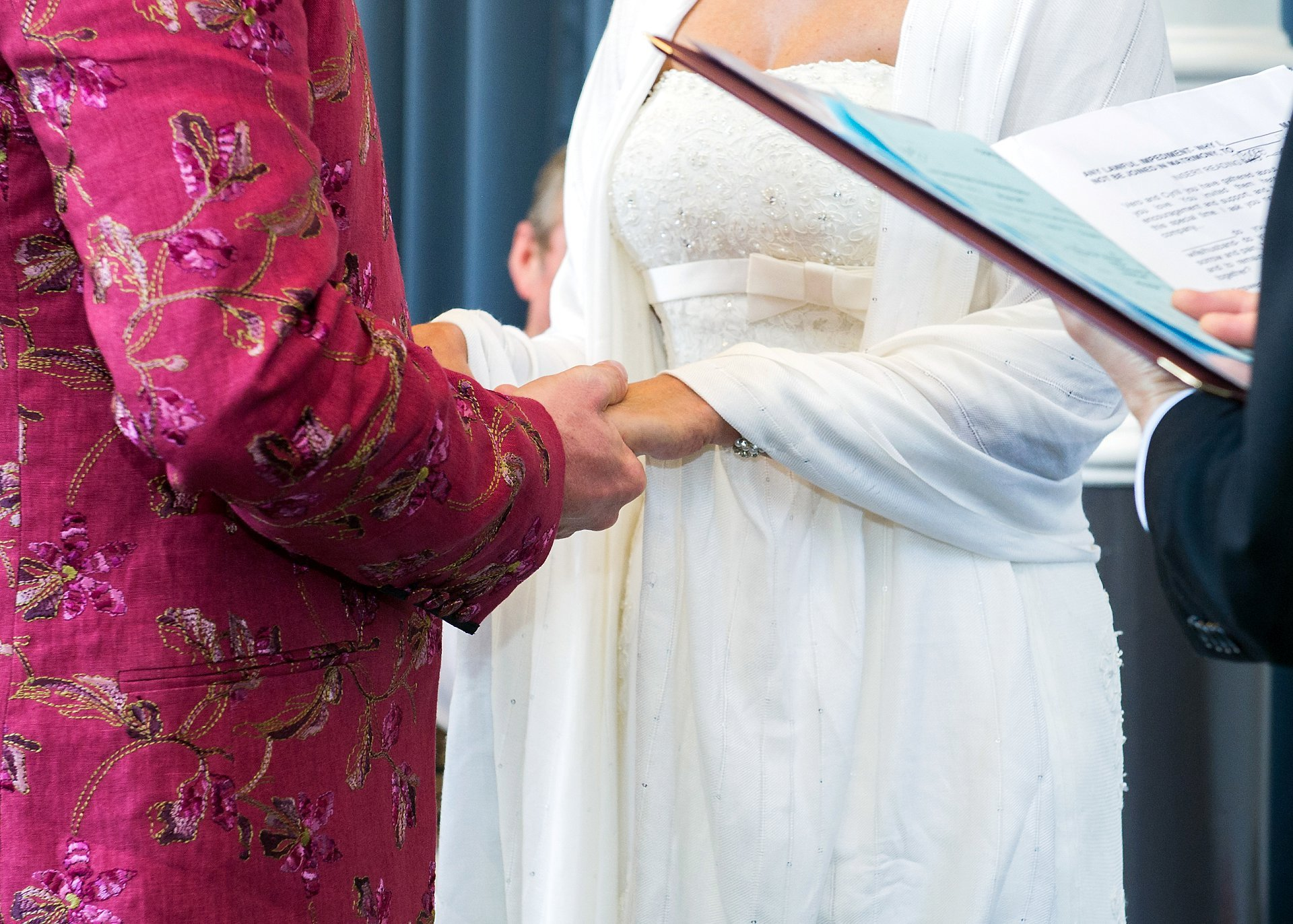 A bride and groom holding hands at this Westminster wedding ceremony
