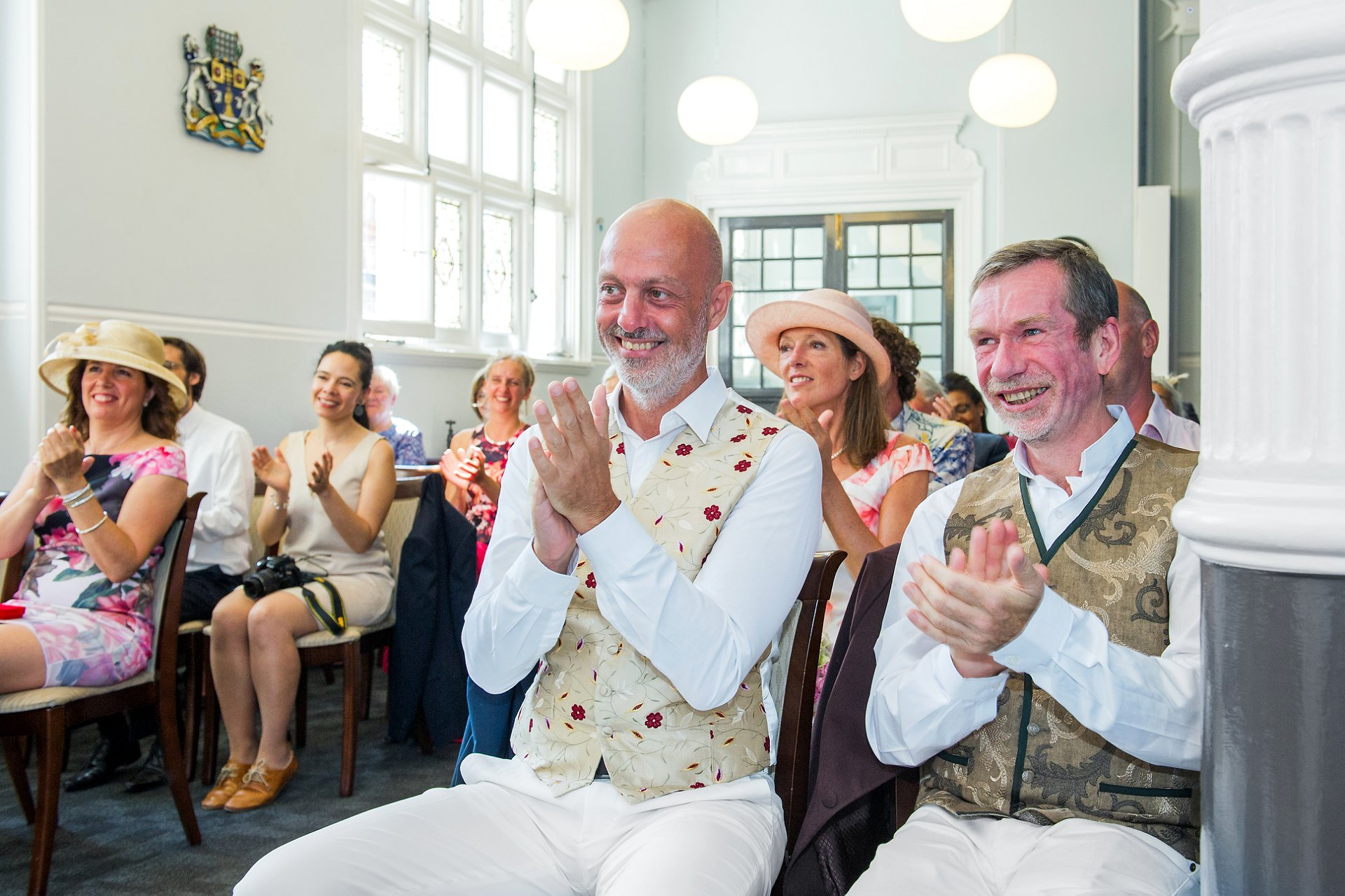Guests clapping the bride and groom at this French wedding in London