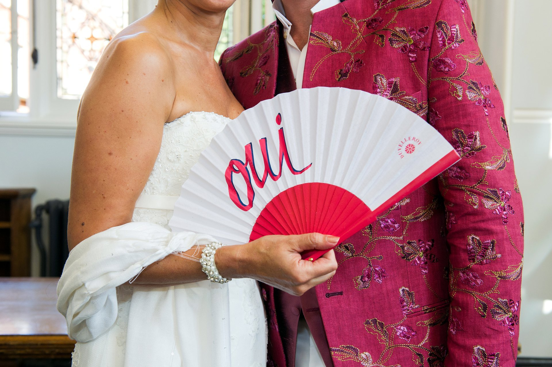 The bride and groom and the 'oui' fan at Mayfair Library