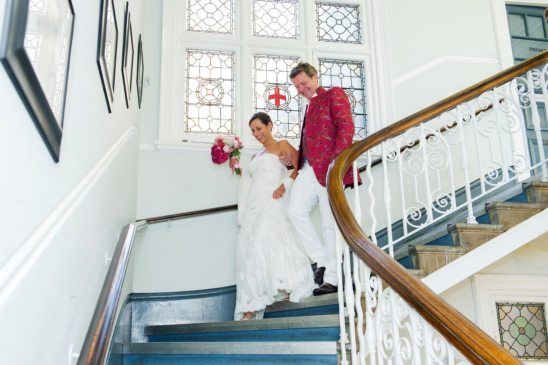 The sweeping staircase at Mayfair Library is very much liked by couples marrying there and here a French couple descend after their civil wedding
