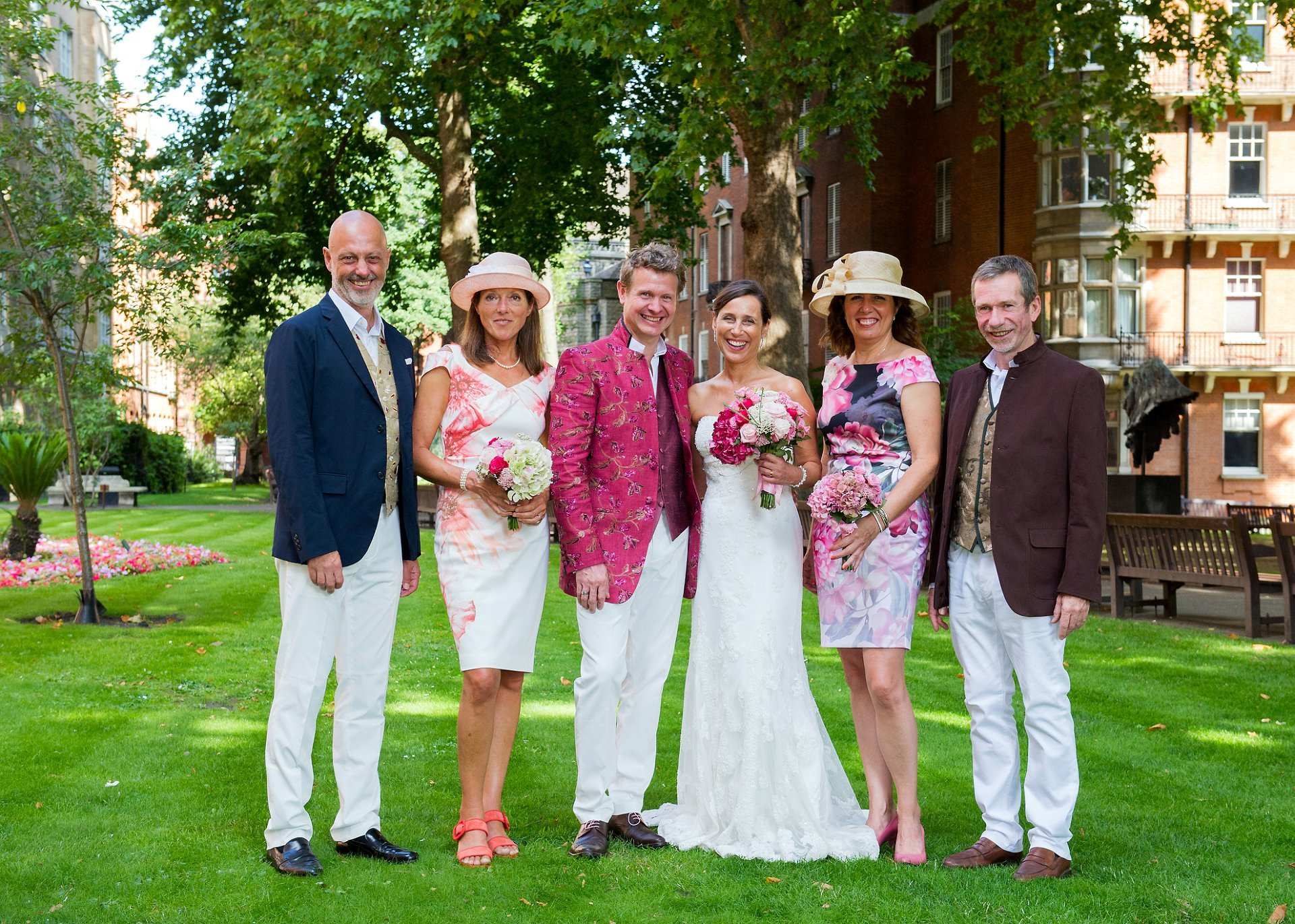 The bride and groom with their friends and witnesses after their Mayfair Library wedding