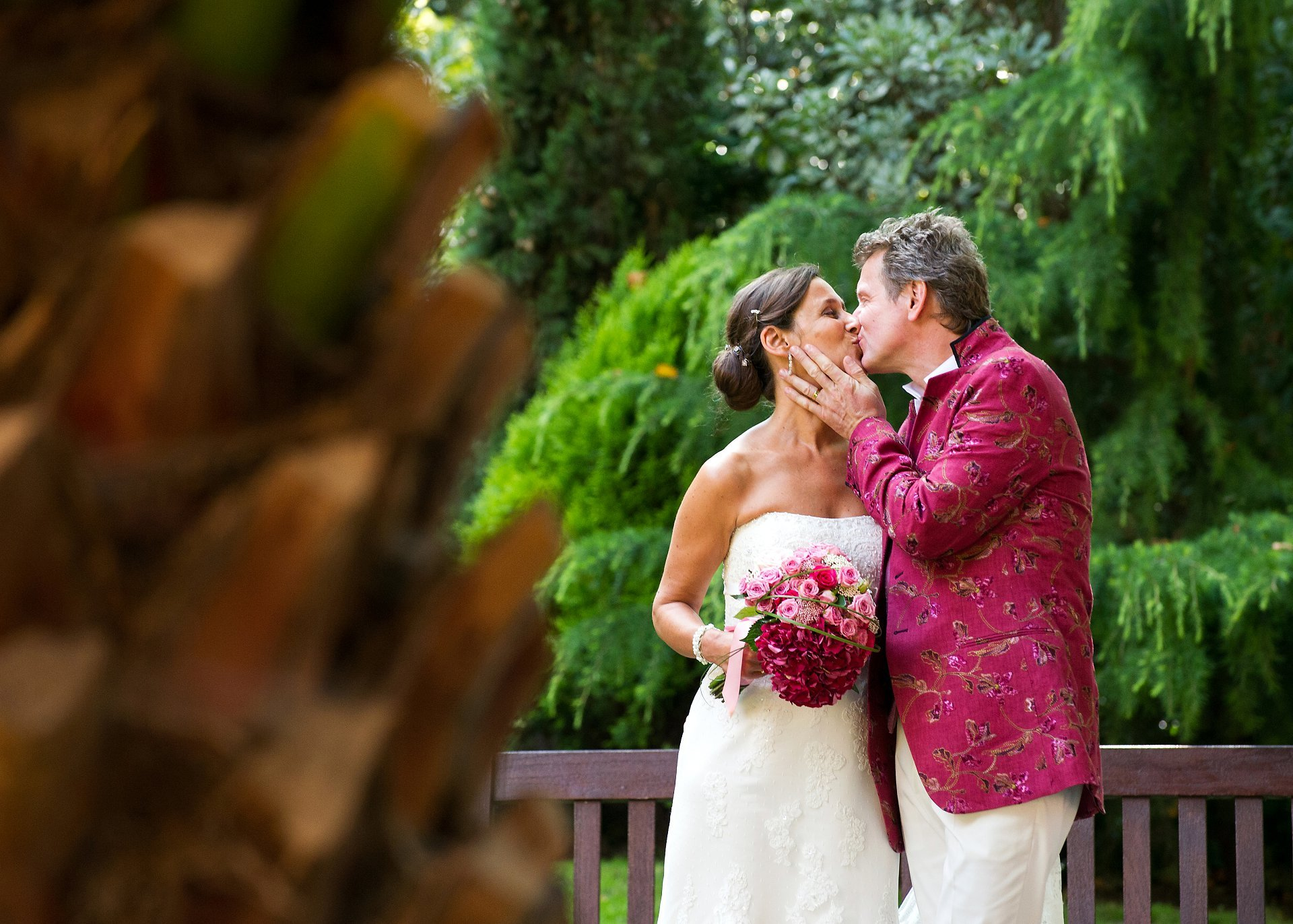 A French bride and groom kissing in Mount Street Gardens after their Westminster wedding