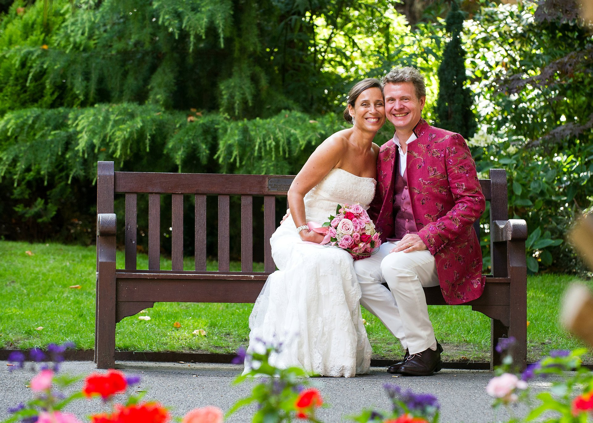Mayfair Library wedding photography by Emma Duggan who specialises in London register office weddings, here a couple sitting on a bench in Mount Street Gardens after their wedding ceremony