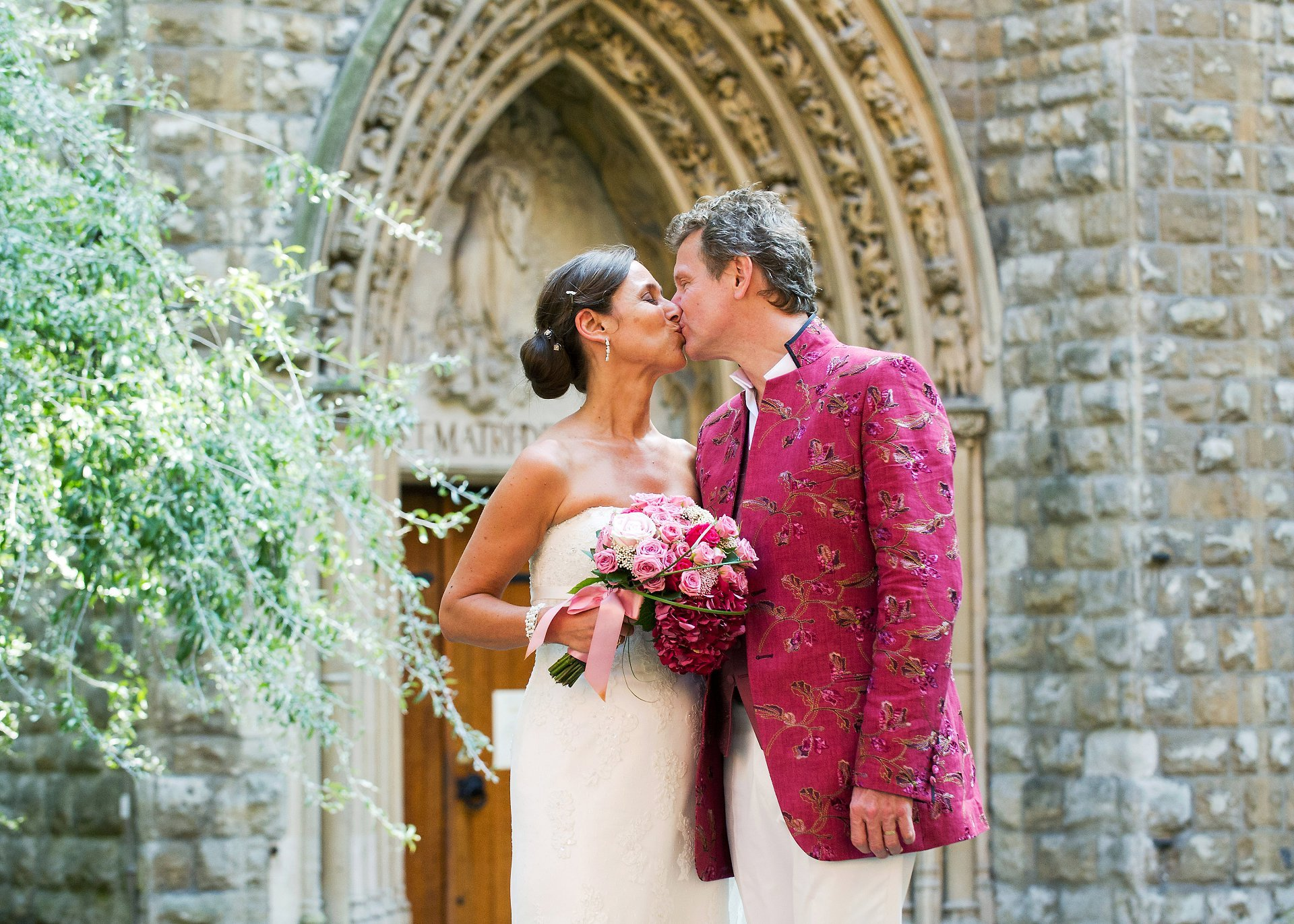 A couple in Mount Street Gardens celebrate their summer wedding at Mayfair Library