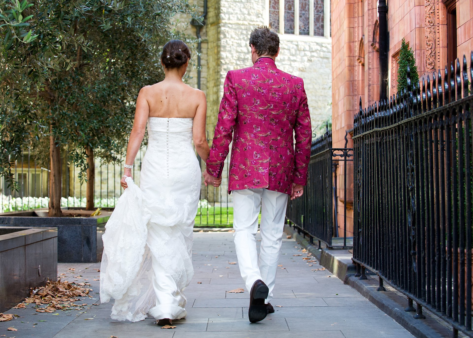 A bride and groom walk away after their Mayfair Library wedding