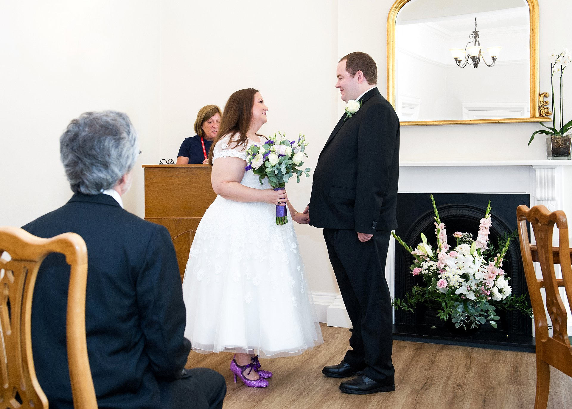 A bride and groom in their civil marriage ceremony at Greenwich Registry Office