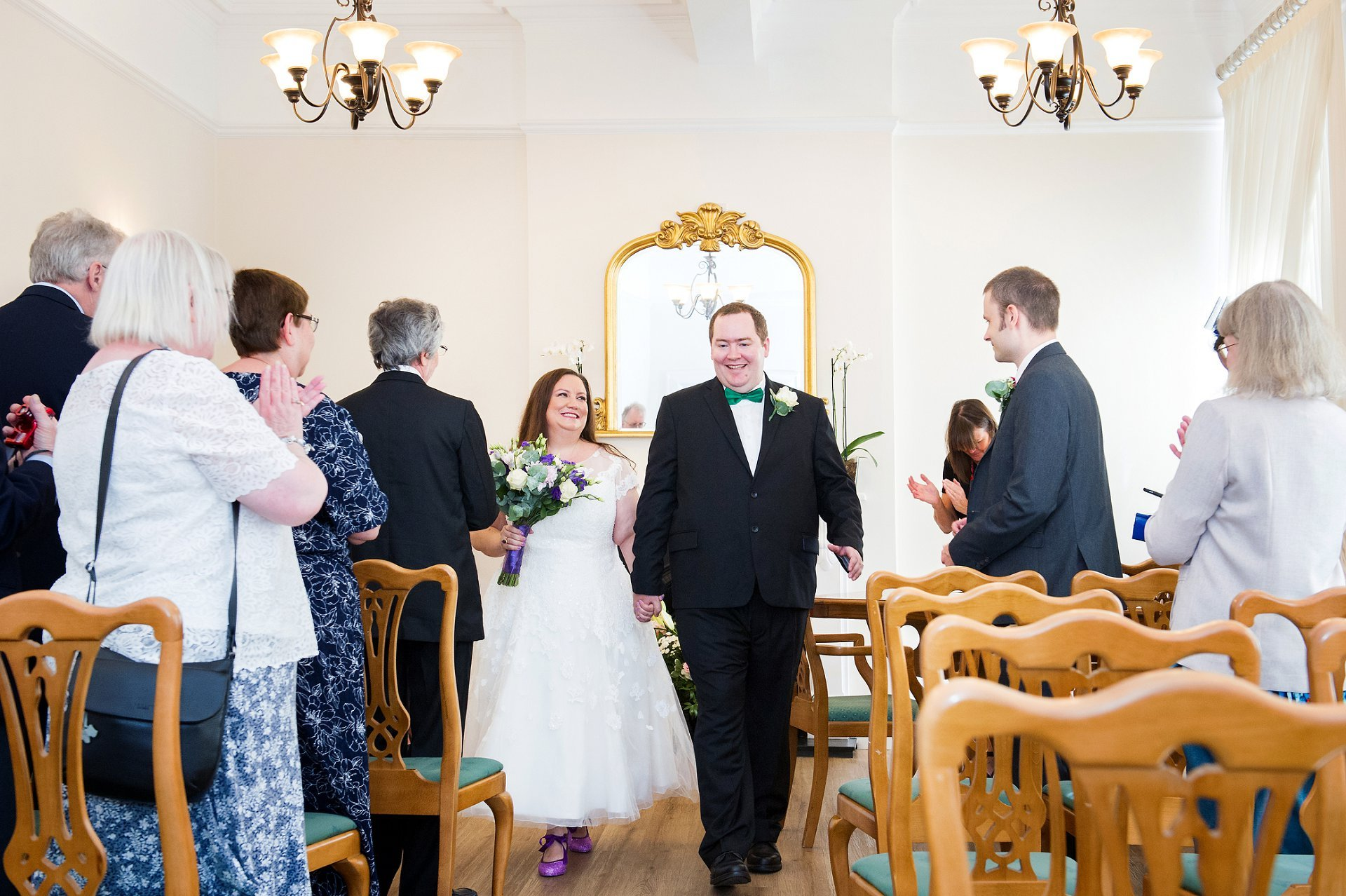 Woolwich Town Hall wedding photographer Emma Duggan captures the bride and groom leaving as husband and wife
