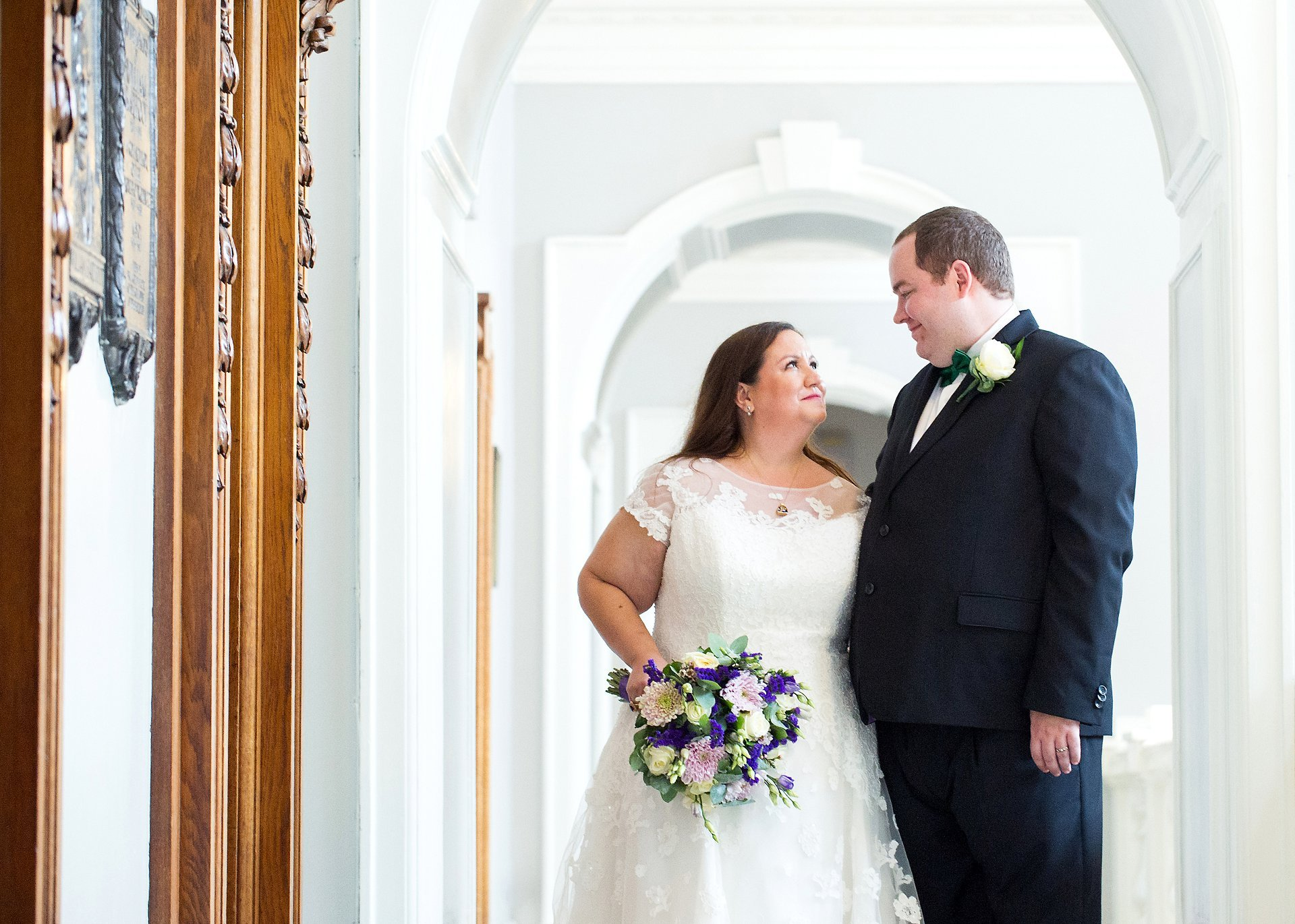 Bride and groom pose for a wedding photograph during their Greenwich wedding at popular venue, Woolwich Town Hall