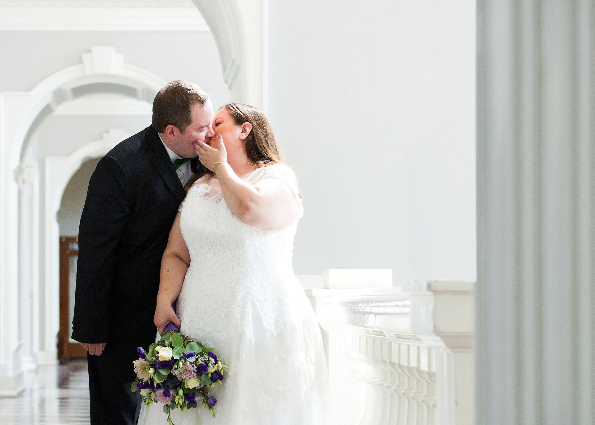 The bride and groom kiss during their couple portrait photography session after their Greenwich wedding